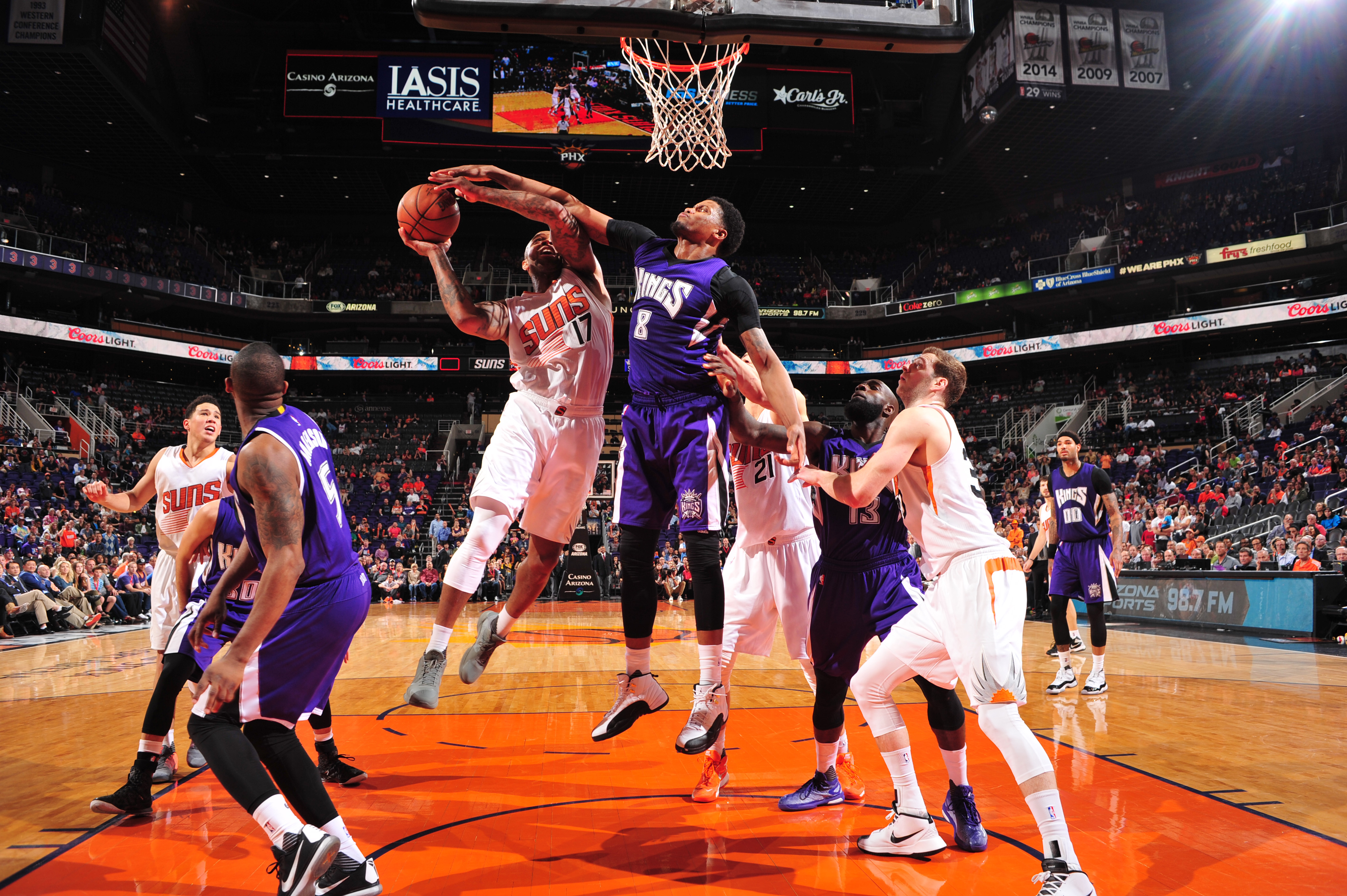 PHOENIX, AZ - APRIL 11:  P.J. Tucker #17 of the Phoenix Suns goes to the basket against Rudy Gay #8 of the Sacramento Kings on April 11, 2016 at Talking Stick Resort Arena in Phoenix, Arizona. (Photo by Barry Gossage/NBAE via Getty Images)