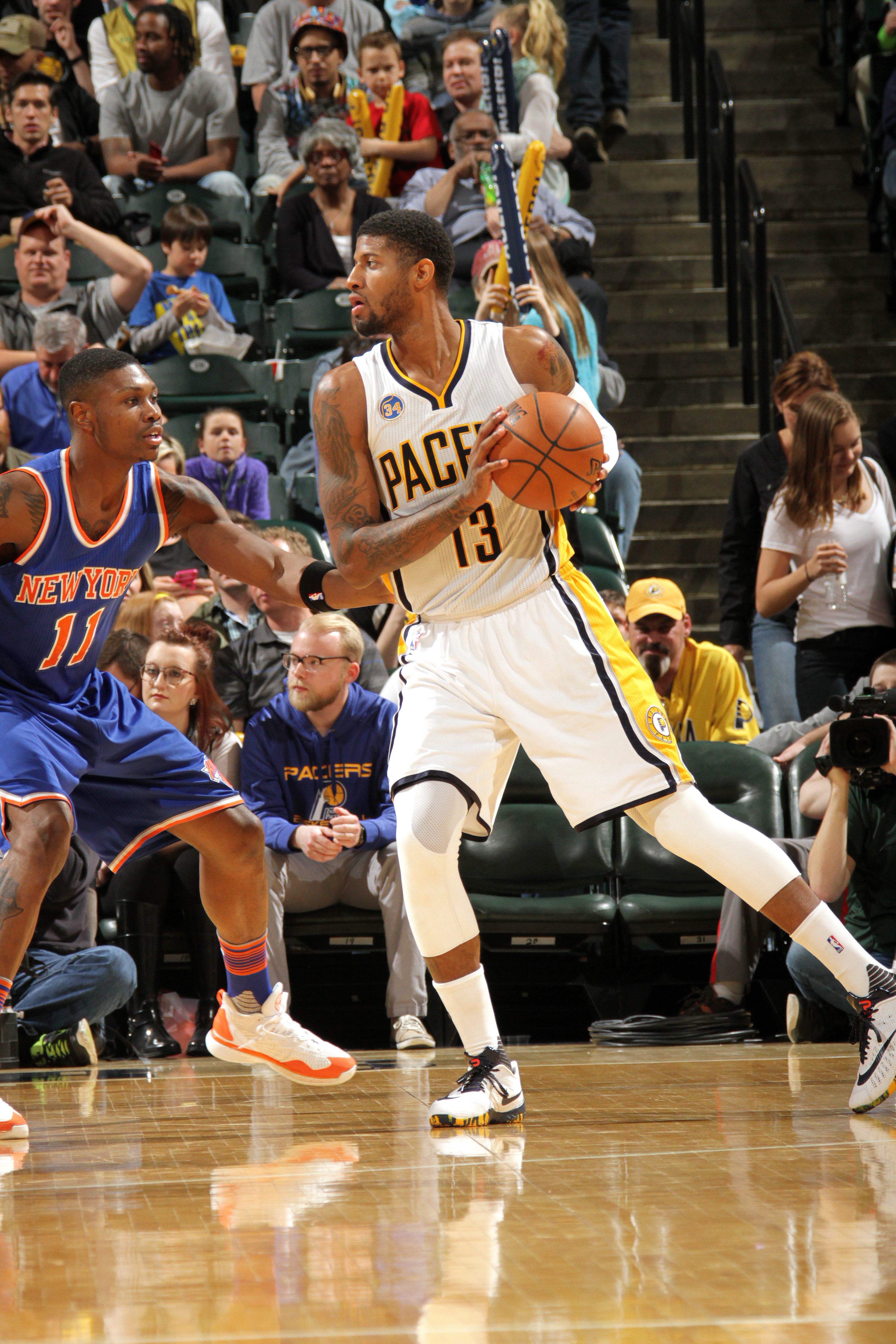 INDIANAPOLIS, IN - APRIL 12: Paul George #13 of the Indiana Pacers handles the ball during the game against the New York Knicks on April 12, 2016 at Bankers Life Fieldhouse in Indianapolis, Indiana. (Photo by Ron Hoskins/NBAE via Getty Images)