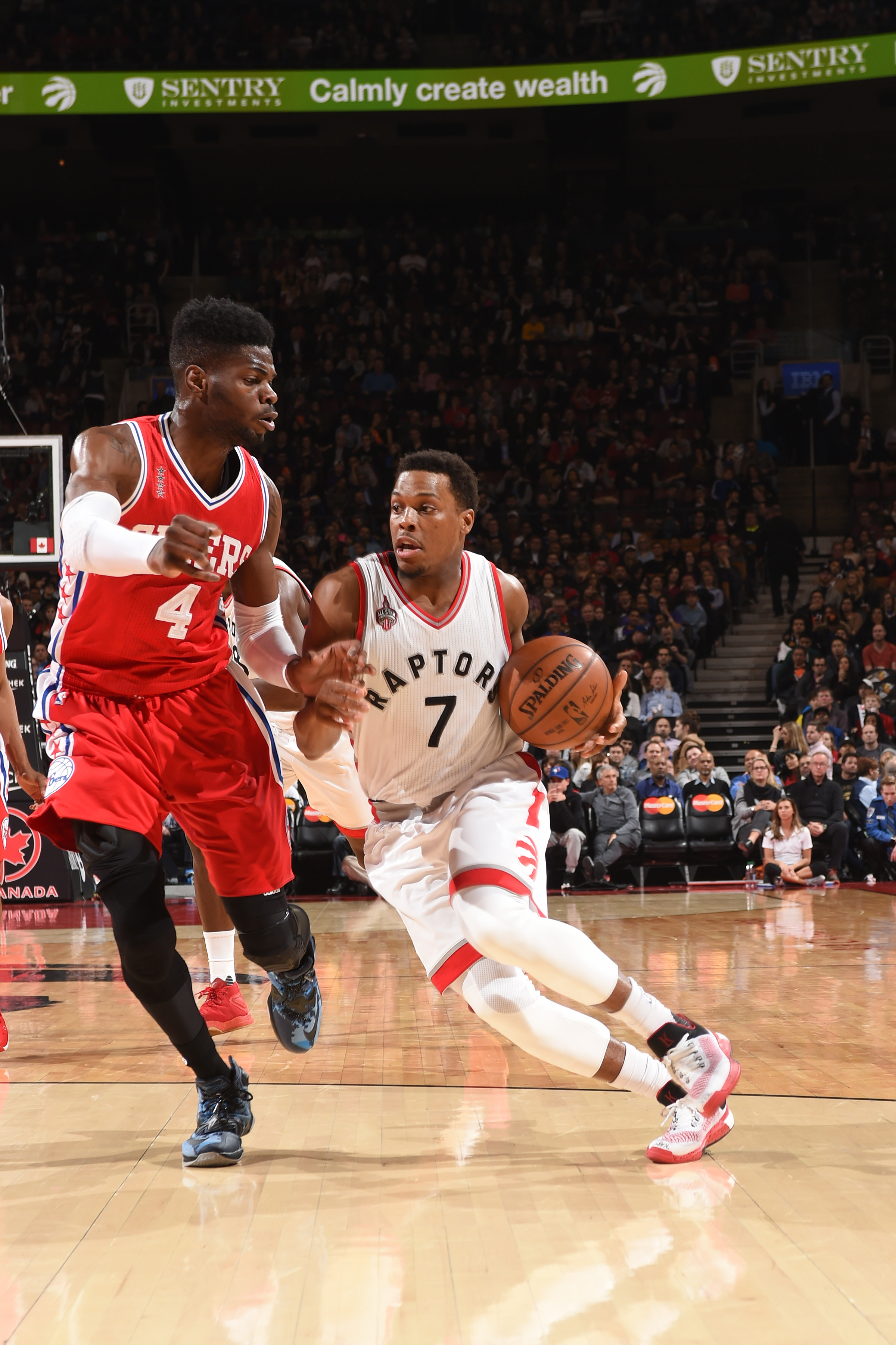 TORONTO, CANADA - APRIL 12: Kyle Lowry #7 of the Toronto Raptors ;htb ;against the Philadelphia 76ers on April 12, 2016 at the Air Canada Centre in Toronto, Ontario, Canada.  (Photo by Ron Turenne/NBAE via Getty Images)