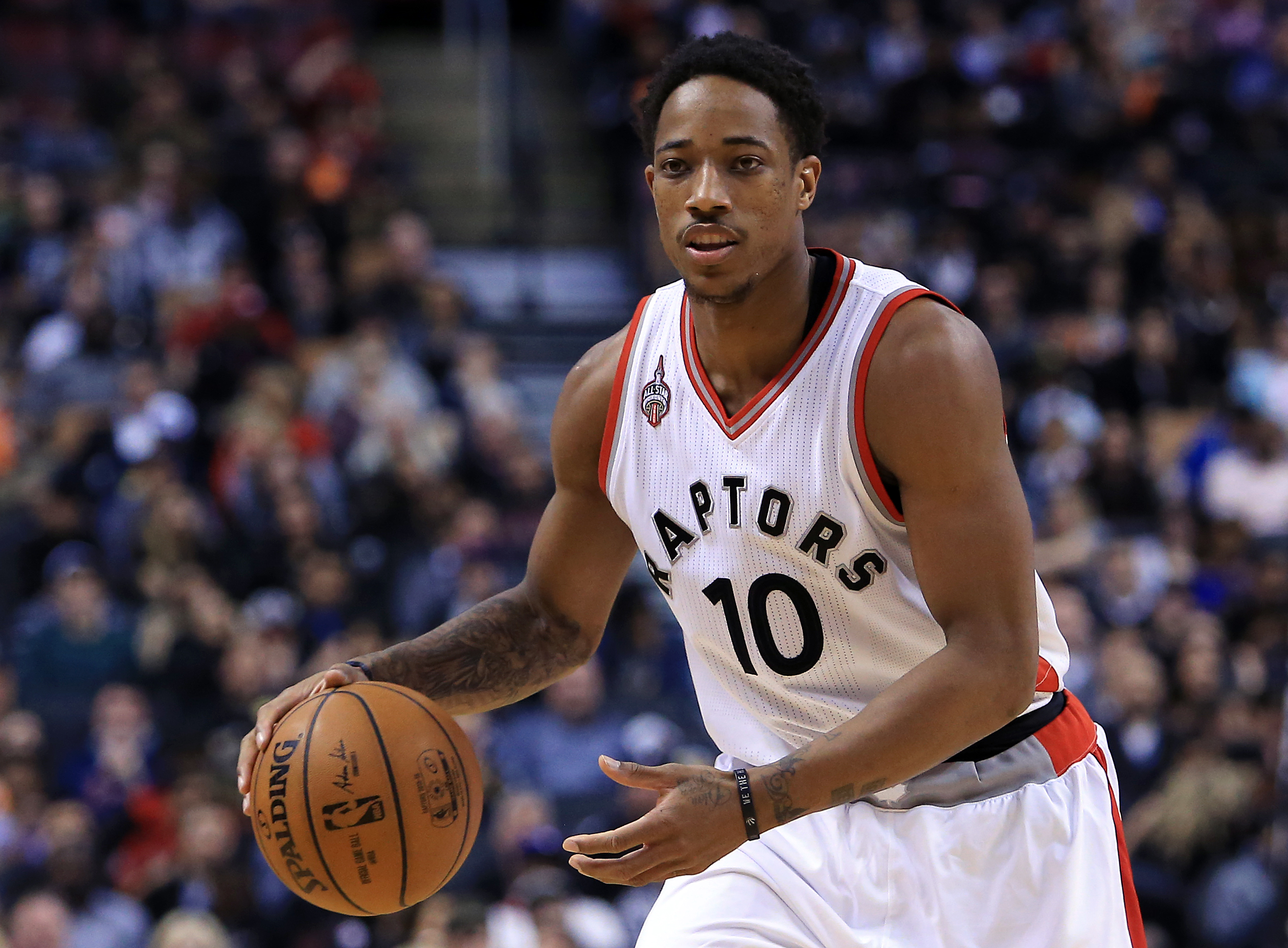 TORONTO, ON - APRIL 12:  DeMar DeRozan #10 of the Toronto Raptors dribbles the ball during the second half of an NBA game against the Philadelphia 76ers at the Air Canada Centre on April 12, 2016 in Toronto, Ontario, Canada.  (Photo by Vaughn Ridley/Getty