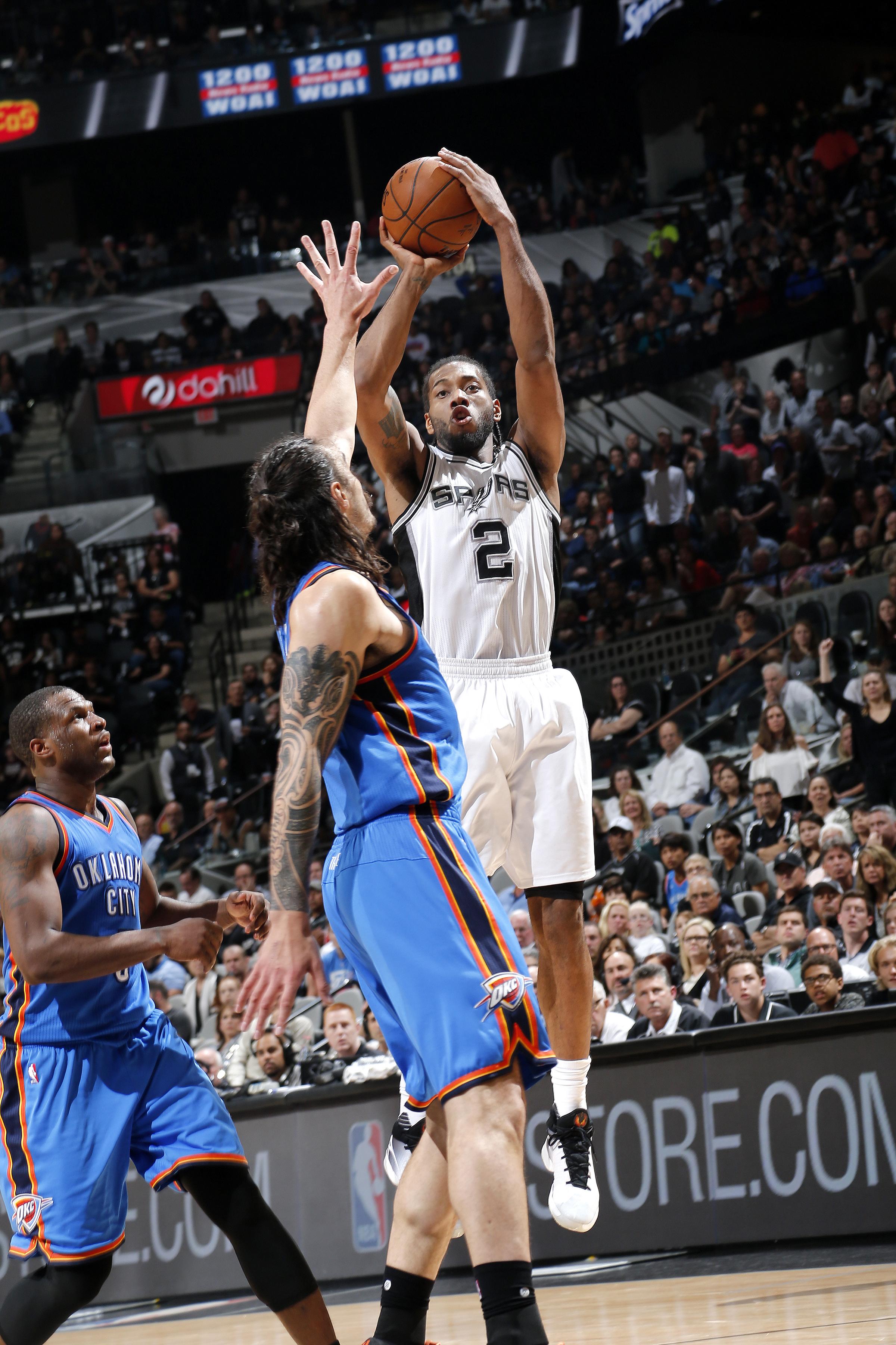 SAN ANTONIO, TX - APRIL 12: Kawhi Leonard #2 of the San Antonio Spurs shoots the ball during the game against the Oklahoma City Thunder on April 12, 2016 at the AT&T Center in San Antonio, Texas.