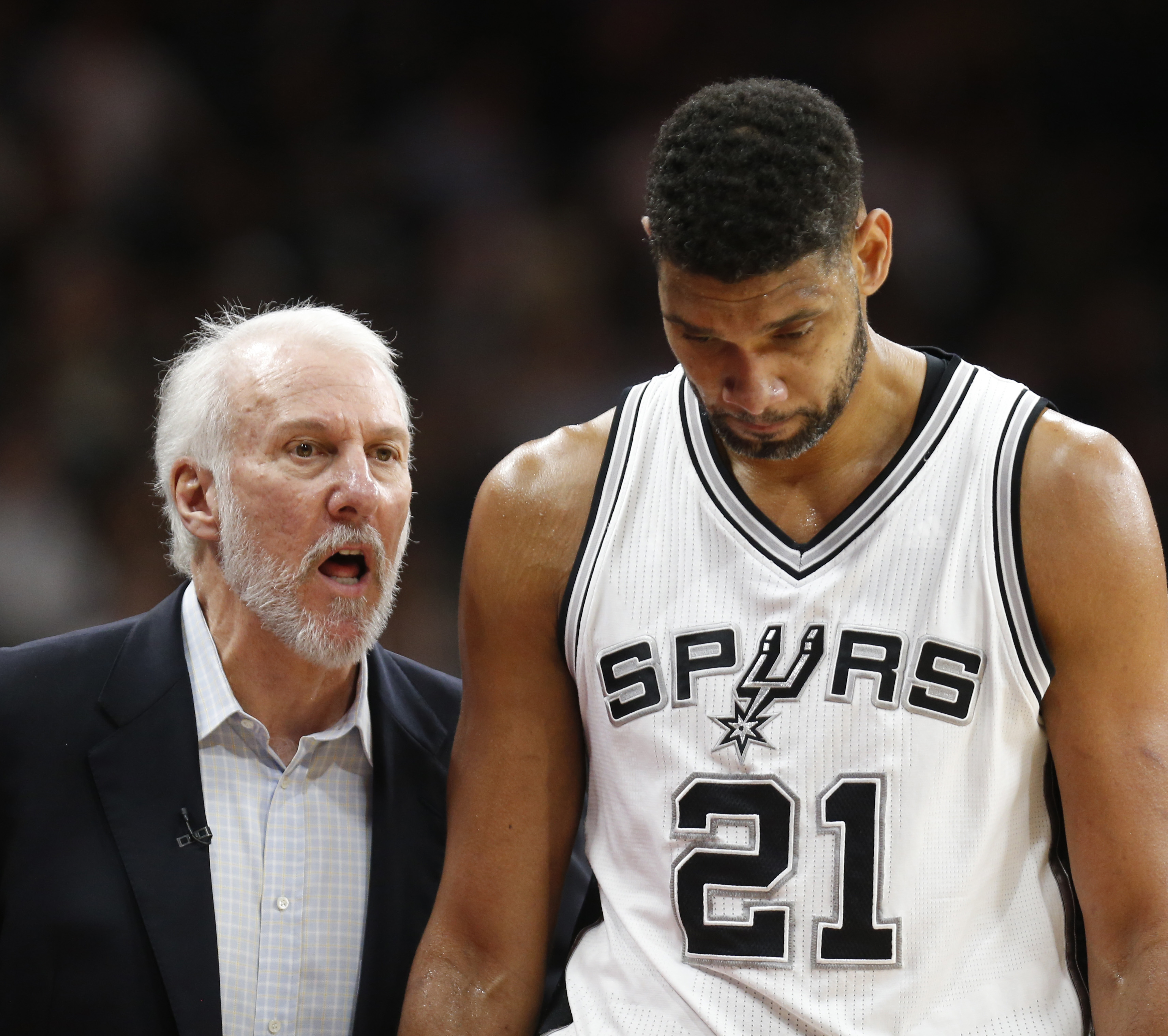 SAN ANTONIO,TX - APRIL 12: San Antonio head coach Gregg Popovic talks with Tim Duncan #21 of the San Antonio Spurs as he comes out against the Oklahoma City Thunder at AT&T Center on April 12, 2016 in San Antonio, Texas.  (Photo by Ronald Cortes/Getty Ima