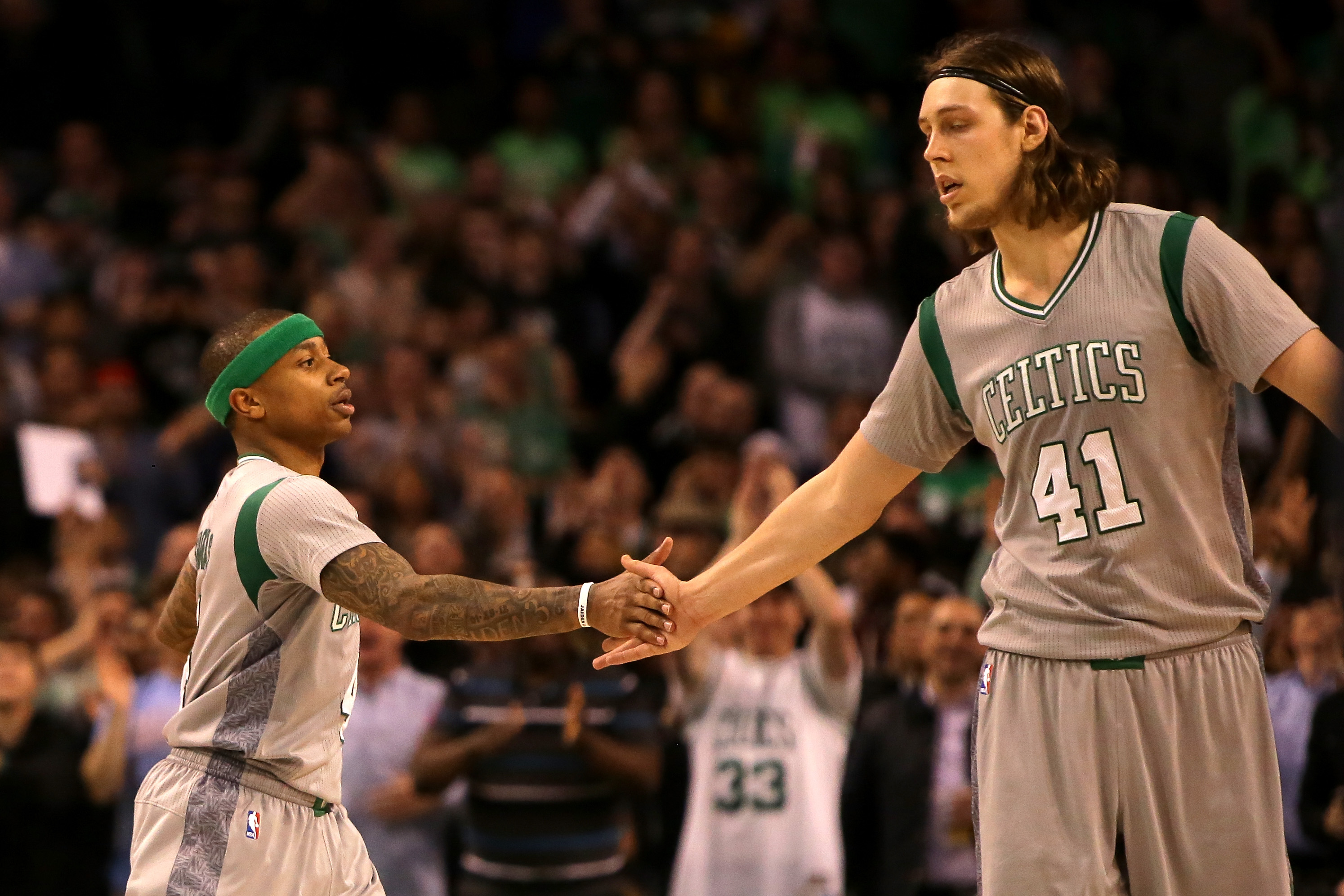 BOSTON, MA - APRIL 13: Isaiah Thomas #4 and Kelly Olynyk #41 of the Boston Celtics celebrate after a play in the fourth quarter against the Miami Heat at TD Garden on April 13, 2016 in Boston, Massachusetts. (Photo by Mike Lawrie/Getty Images)