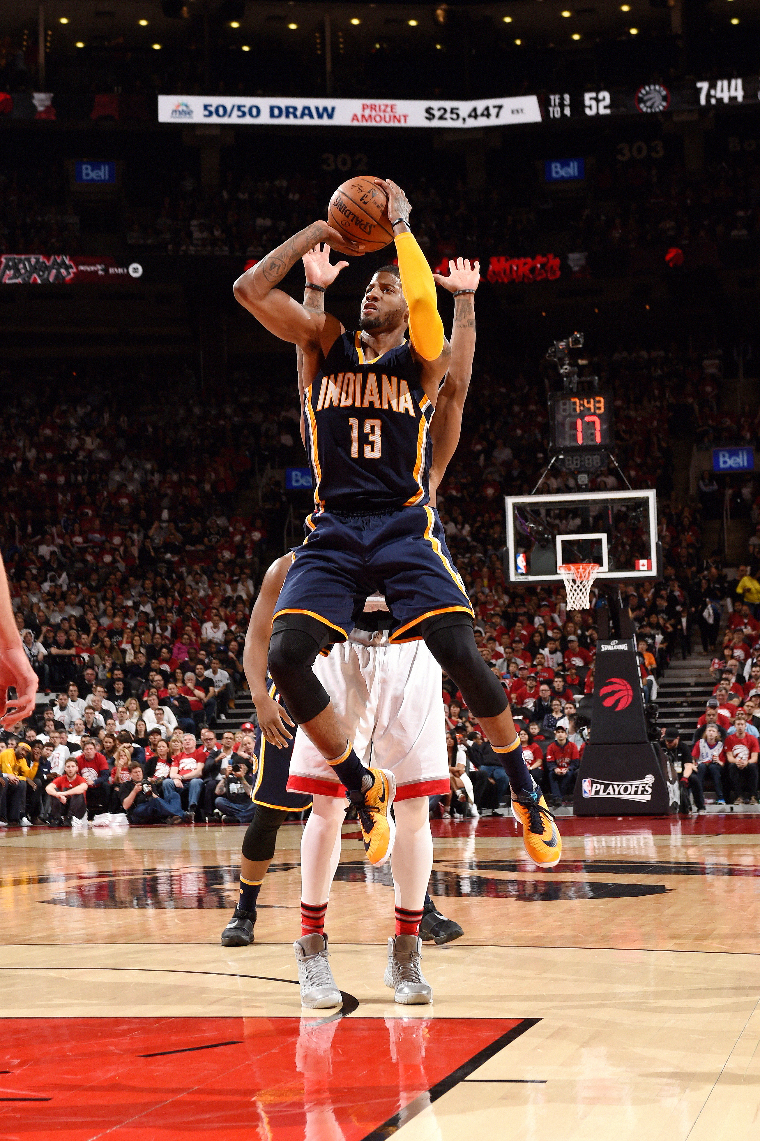 TORONTO, CANADA - APRIl 16: Paul George #13 of the Indiana Pacers shoots the ball during the game against the Toronto Raptors in Game One of the Eastern Conference Finals during the 2016 NBA Playoffs on April 16, 2016 at the Air Canada Centre in Toronto,