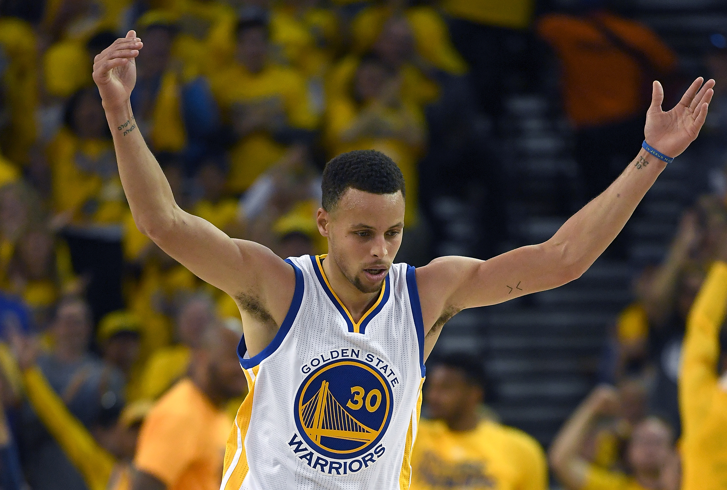 OAKLAND, CA - APRIL 16:  Stephen Curry #30 of the Golden State Warriors reacts after hitting a three-point shot against the Houston Rockets in the second quarter in Game One of the Western Conference Quarterfinals during the 2016 NBA Playoffs at ORACLE Ar