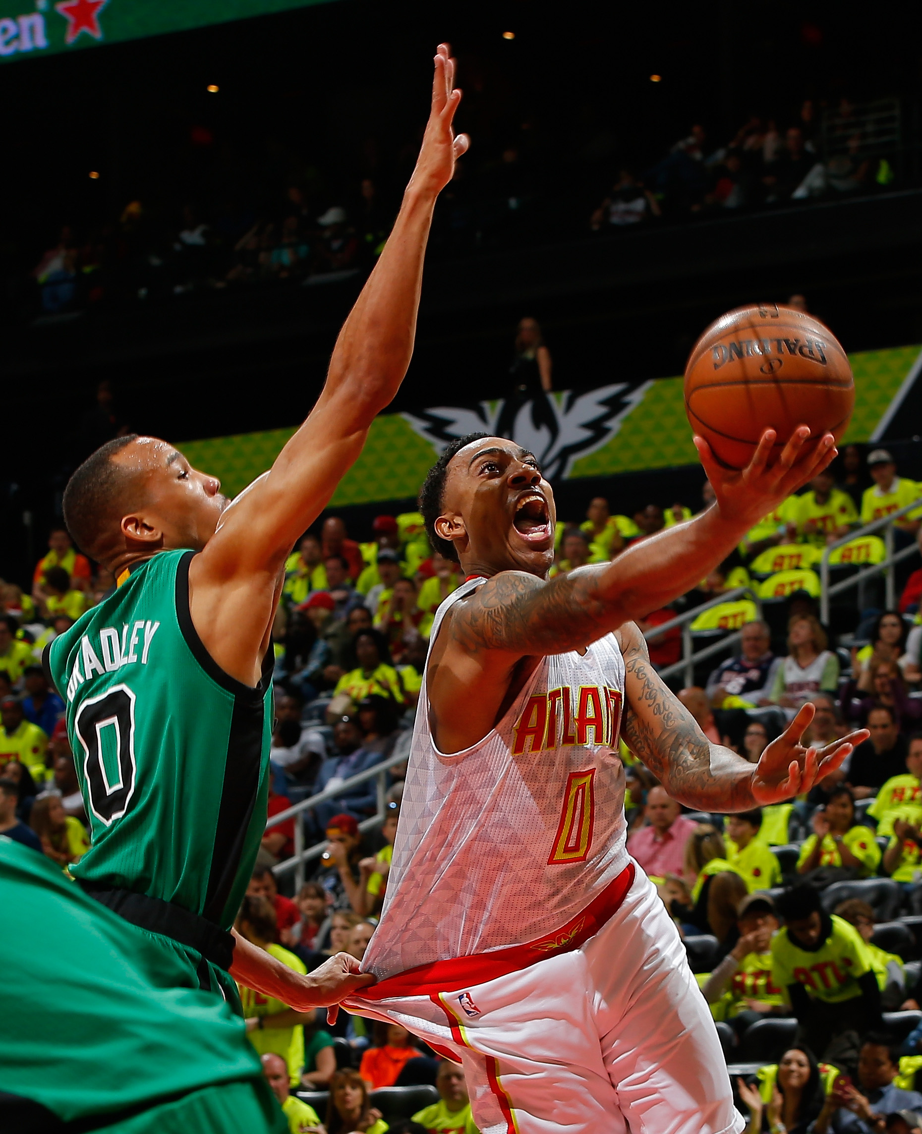 ATLANTA, GA - APRIL 16:  Jeff Teague #0 of the Atlanta Hawks lays in a basket against Avery Bradley #0 of the Boston Celtics in Game One of the Eastern Conference Quarterfinals during the 2016 NBA Playoffs at Philips Arena on April 16, 2016 in Atlanta, Ge