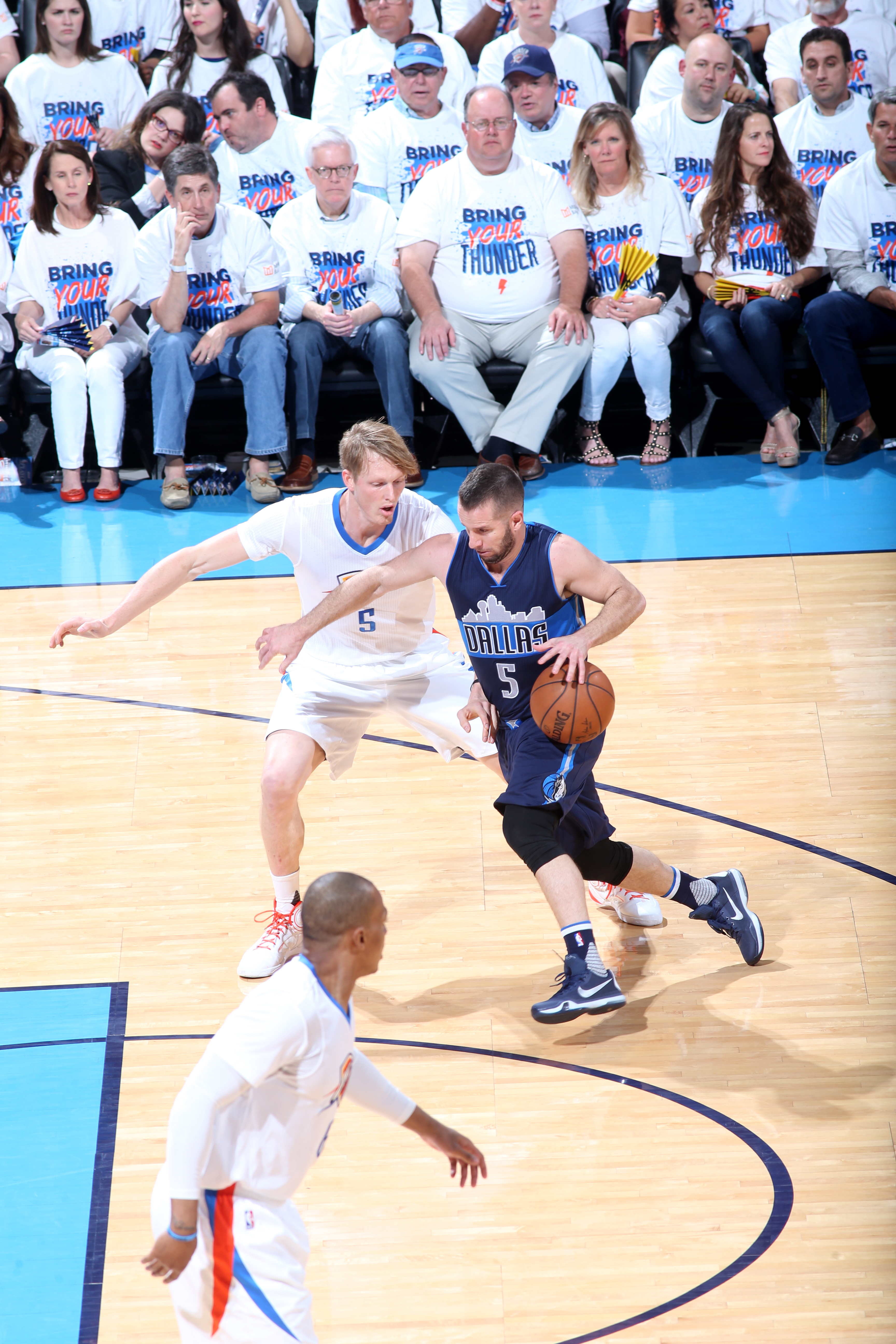 OKLAHOMA CITY, OK - APRIL 16:  J.J. Barea #5 of the Dallas Mavericks drives to the basket against Kyle Singler #5 of the Oklahoma City Thunder in Game One of the Western Conference Quarterfinals during the 2016 NBA Playoffs on April 16, 2016 at Chesapeake