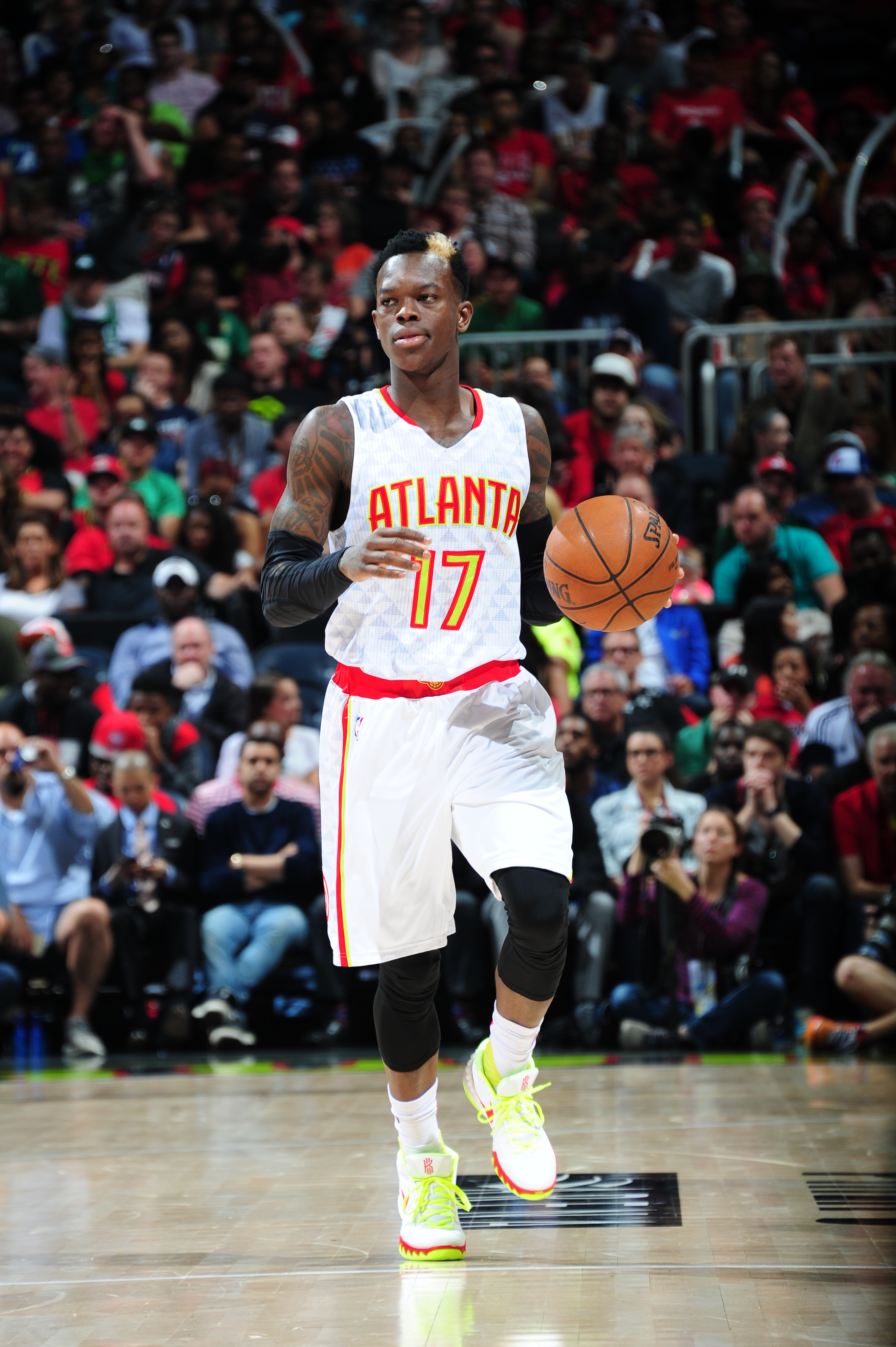 ATLANTA, GA - APRIL 19:  Dennis Schroder #17 of the Atlanta Hawks brings the ball up court against the Boston Celtics in Game Two of the Eastern Conference Quarterfinals during the 2016 NBA Playoffs on April 19, 2016 at Philips Arena in Atlanta, Georgia.