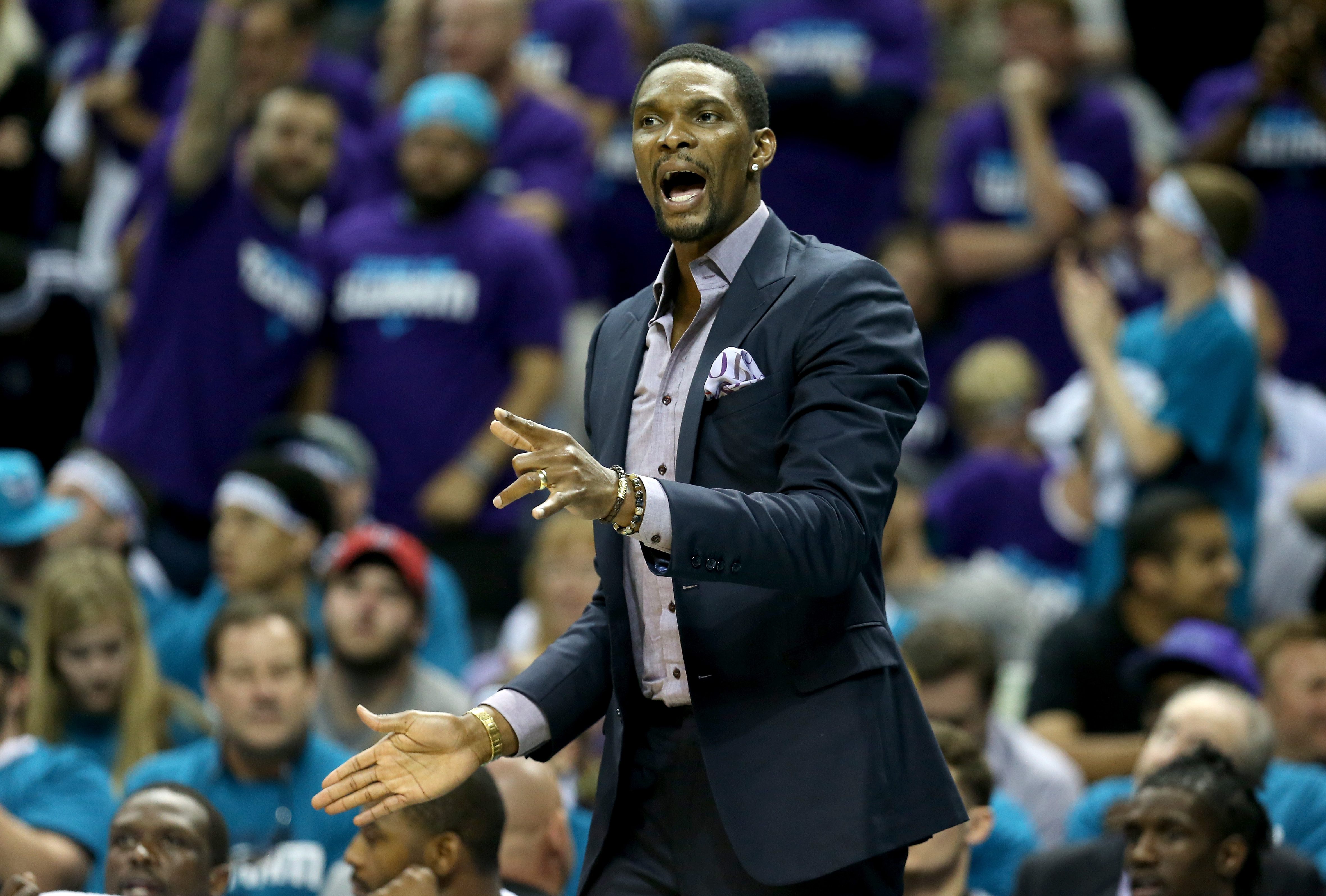 CHARLOTTE, NC - APRIL 25:  Chris Bosh #1 of the Miami Heat watches on from the bench against the Charlotte Hornets during game four of the Eastern Conference Quarterfinals of the 2016 NBA Playoffs at Time Warner Cable Arena on April 25, 2016 in Charlotte,