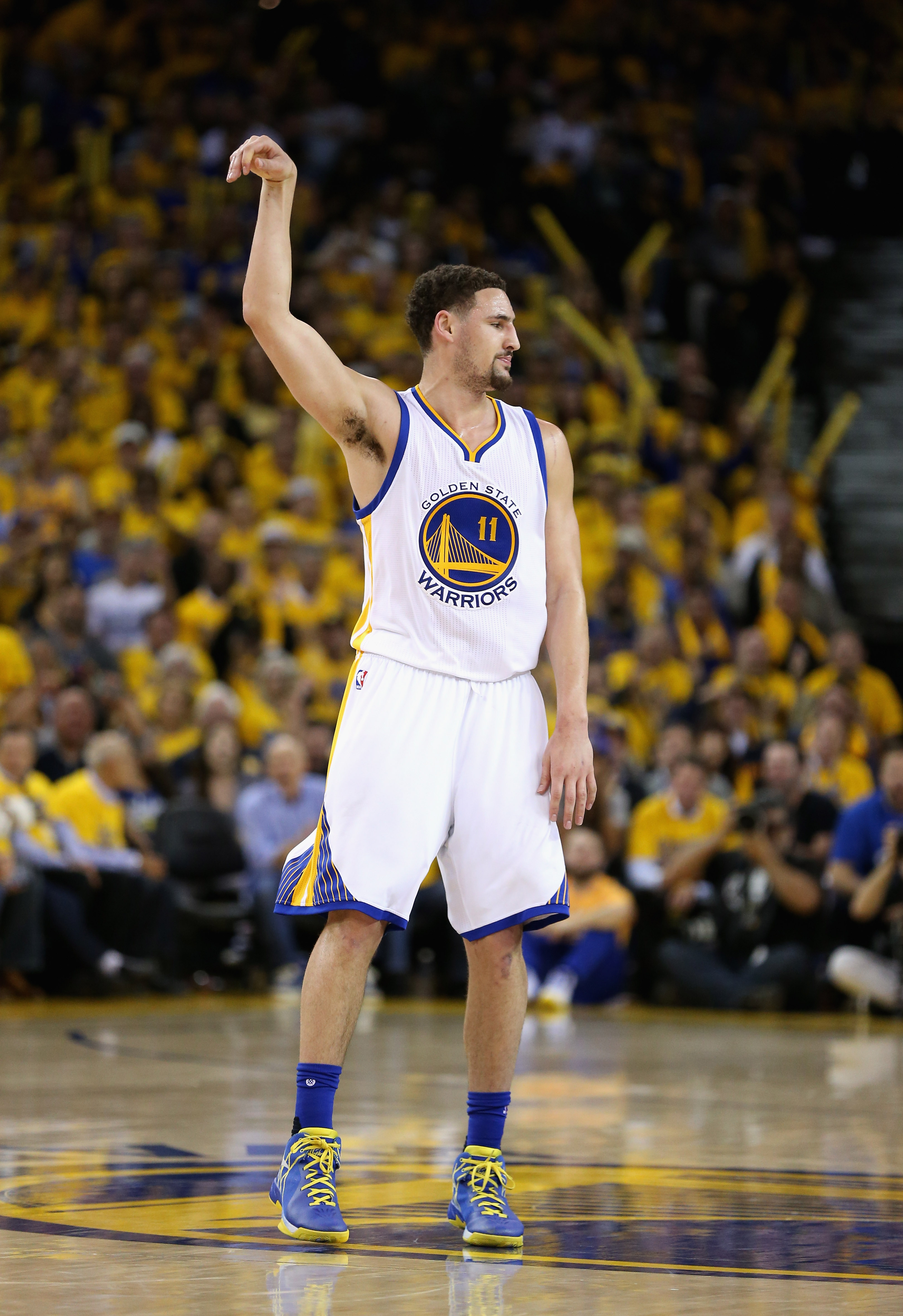 OAKLAND, CA - APRIL 27:  Klay Thompson #11 of the Golden State Warriors reacts after making a three-point basket against the Houston Rockets in Game Five of the Western Conference Quarterfinals during the 2016 NBA Playoffs at ORACLE Arena on April 27, 201