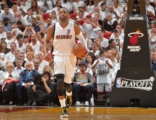 MIAMI,FL - APRIL 27:  Dwyane Wade #3 of the Miami Heat dribbles up court against the Charlotte Hornets during the Eastern Conference playoffs First Round Game Five on April 27, 2016 at the American Airlines Arena in Miami, Florida. (Photo by Jesse D. Garr