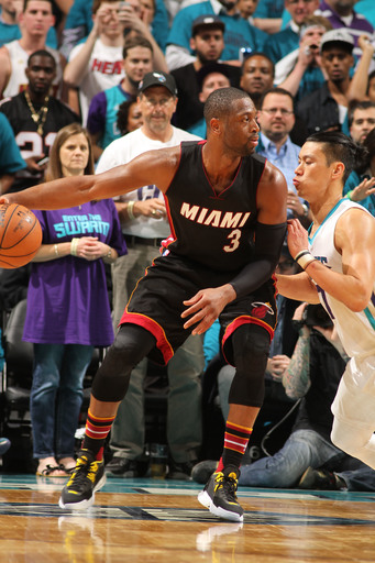 CHARLOTTE, NC - APRIL 29:  Dwyane Wade #3 of the Miami Heat drives against Jeremy Lin #7 of the Charlotte Hornets in Game Six of the Eastern Conference Quarterfinals during the 2016 NBA Playoffs on April 29, 2016 at Time Warner Cable Arena in Charlotte, N