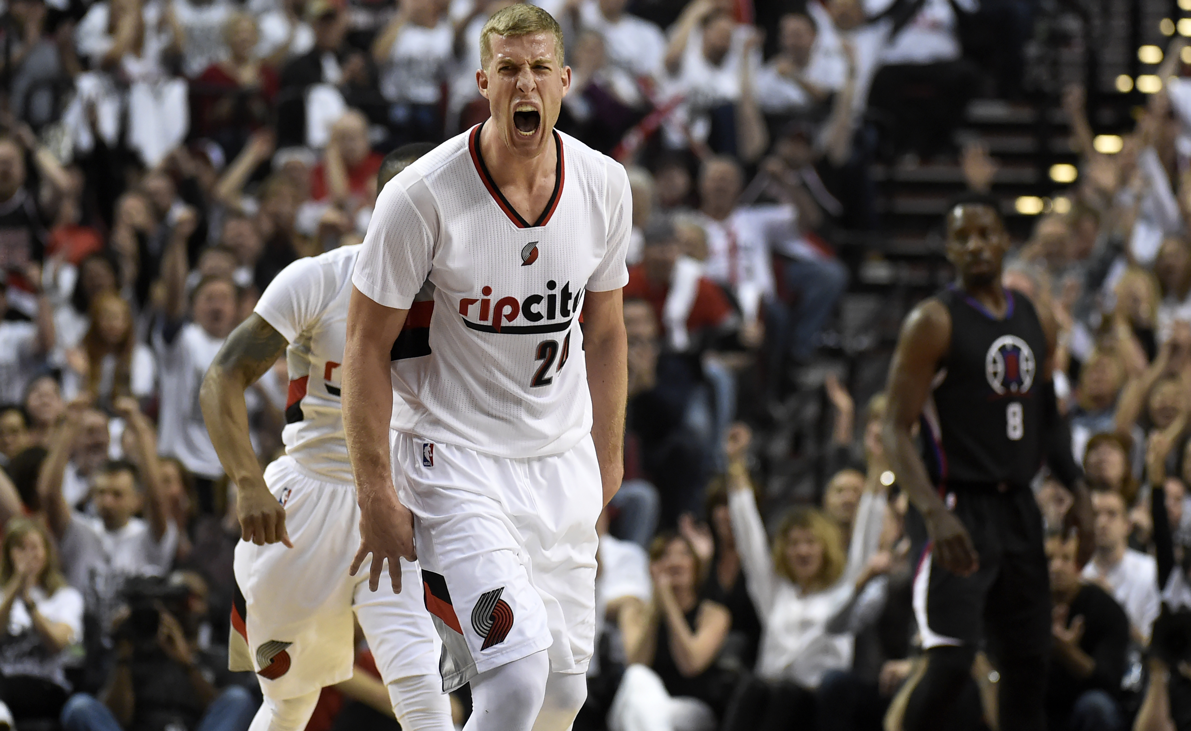*** BESTPIX *** PORTLAND, OR - APRIL 29: Mason Plumlee #24 of the Portland Trail Blazers celebrates after his teammate scores in the first quarter of Game Six of the Western Conference Quarterfinals against the Los Angeles Clippers during the 2016 NBA Pla