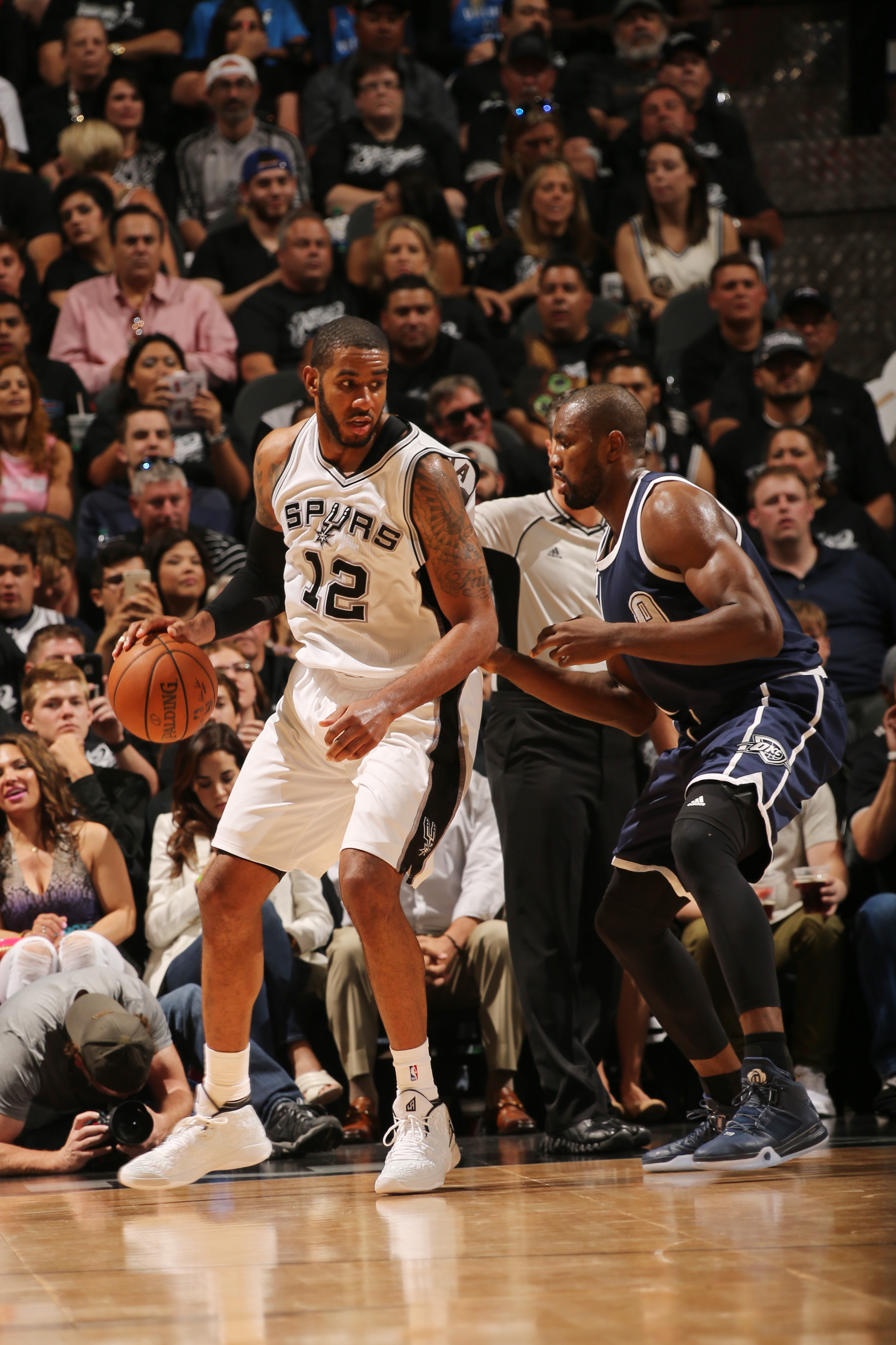 SAN ANTONIO, TX - APRIL 30: LaMarcus Aldridge #12 of the San Antonio Spurs handles the ball against the Oklahoma City Thunder in Game One of Western Conference Semifinals of the 2016 NBA Playoffs on April 30, 2016 at the AT&T Center in San Antonio, Texas