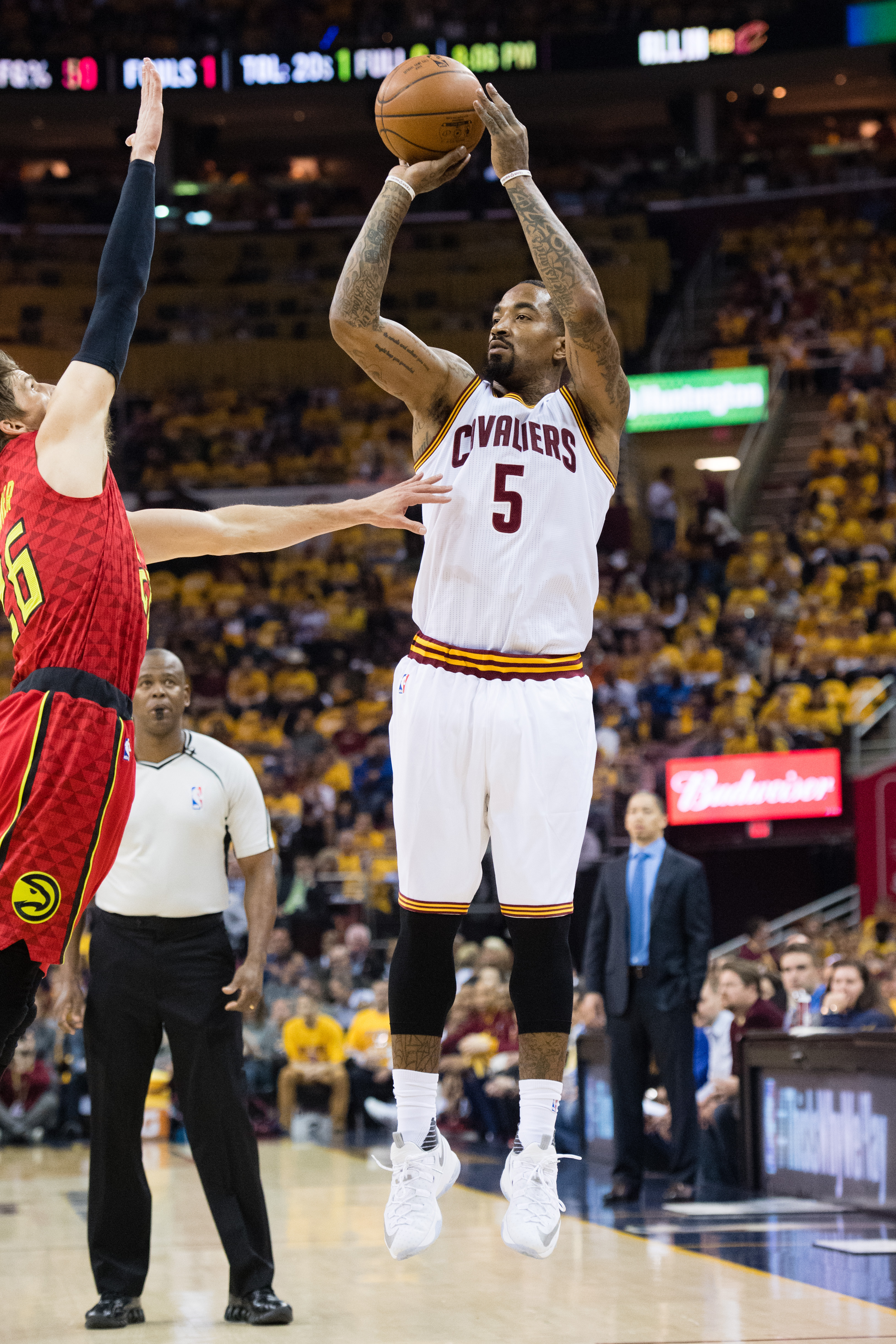 CLEVELAND, OH - MAY 4: J.R. Smith #5 of the Cleveland Cavaliers shoots a three point jump shot over Kyle Korver #26 of the Atlanta Hawks during the first half of the NBA Eastern Conference semifinals at Quicken Loans Arena on May 4, 2016 in Cleveland, Ohi