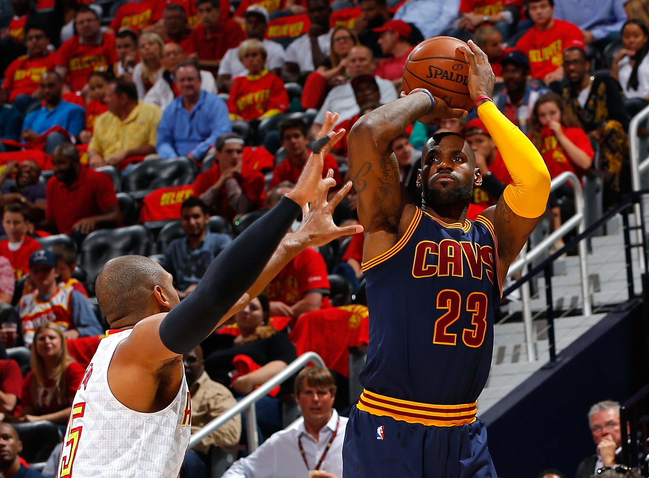 ATLANTA, GA - MAY 06:  LeBron James #23 of the Cleveland Cavaliers shoots against Al Horford #15 of the Atlanta Hawks in Game Three of the Eastern Conference Semifinals during the 2016 NBA Playoffs at Philips Arena on May 6, 2016 in Atlanta, Georgia.  NOT