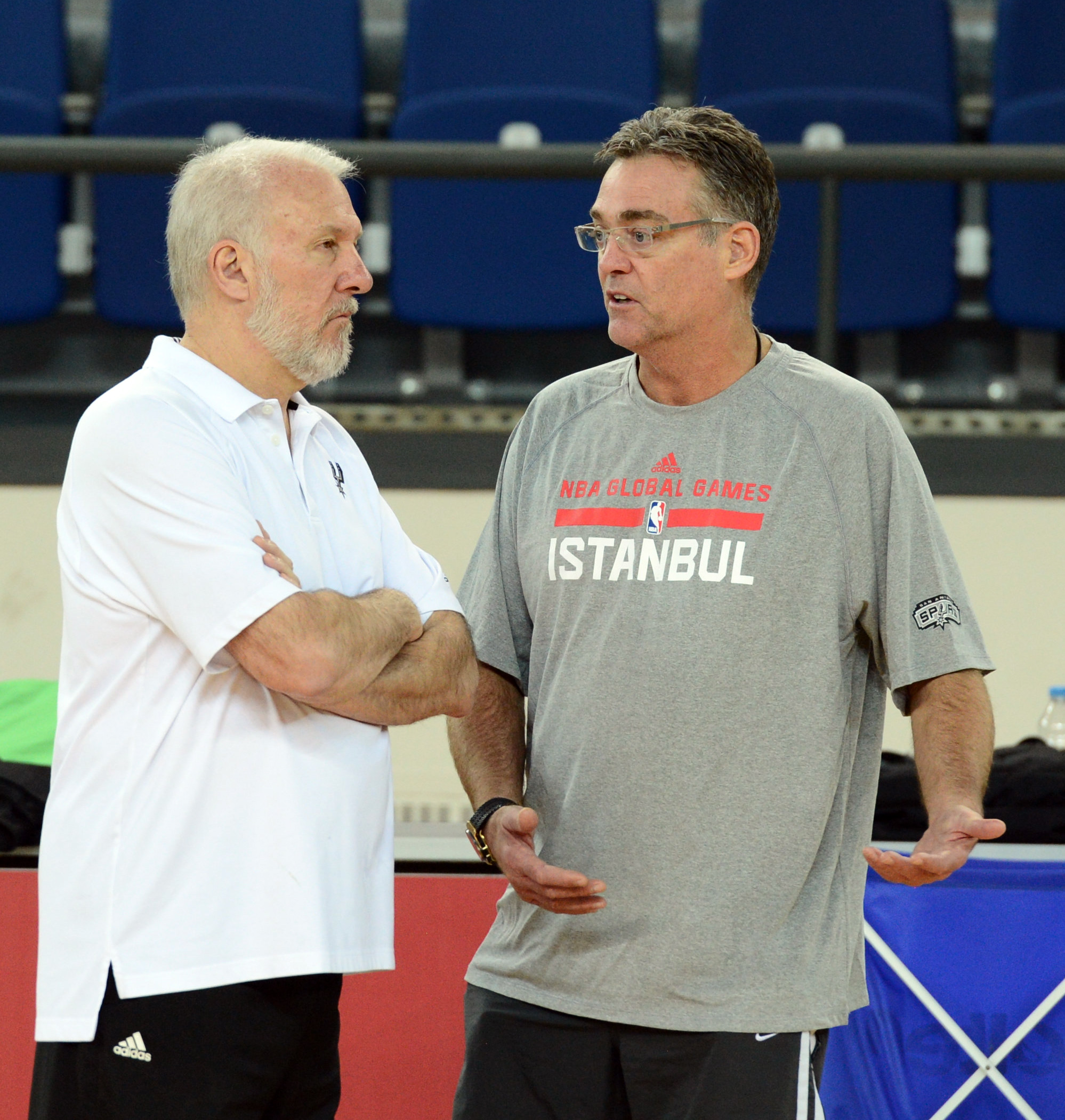 ISTANBUL, TURKEY - OCTOBER 10:  Head Coach Gregg Popovich and General Manager R.C. Buford of the San Antonio Spurs talk during practice as part of the NBA Global Games on October 10, 2014 at the Darussafaka Practice Facility in Istanbul, Turkey. (Photo by