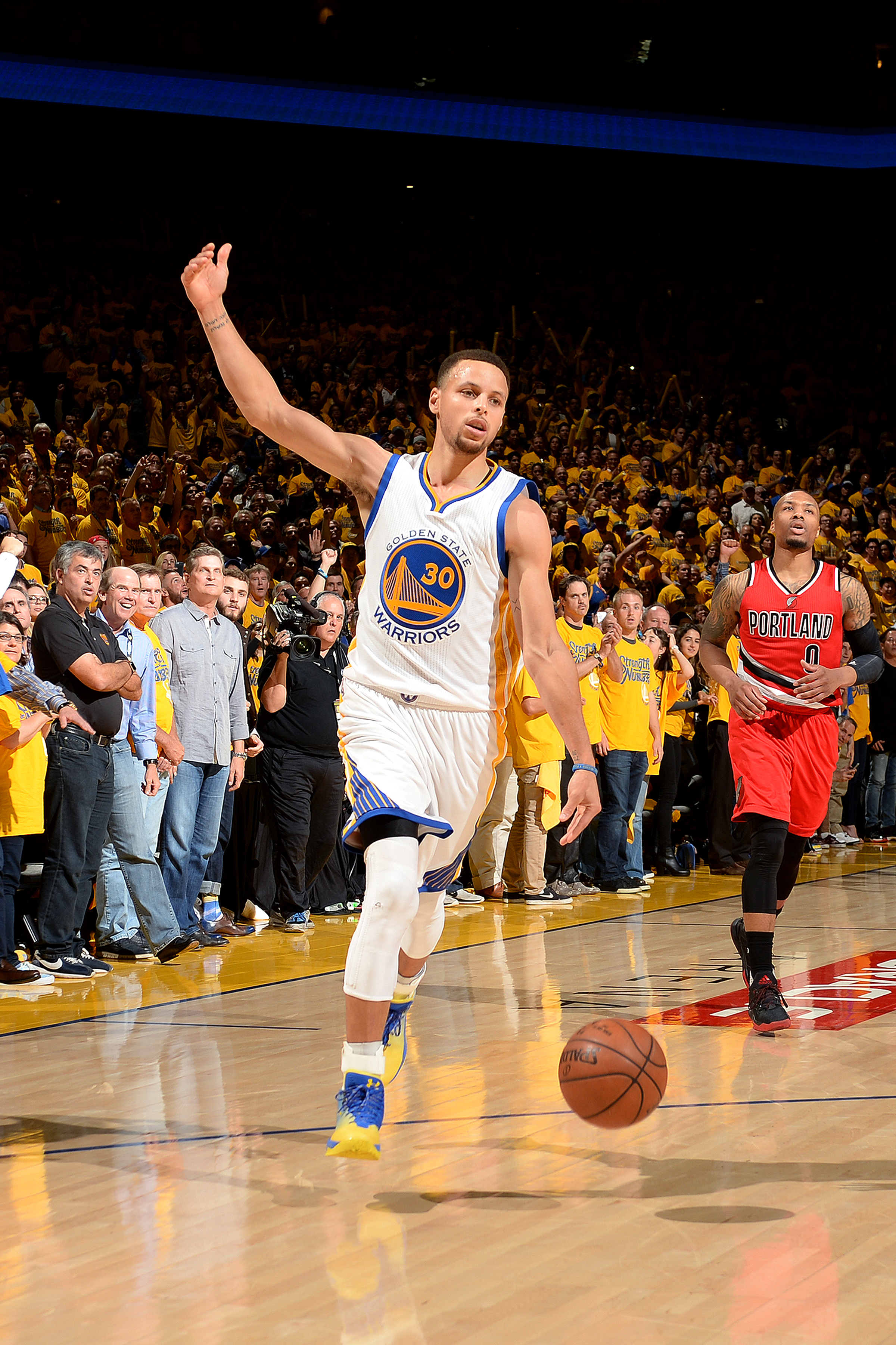OAKLAND, CA - MAY 11: Stephen Curry #30 of the Golden State Warriors handles the ball during the game against the Portland Trail Blazers in Game Five of the Western Conference Semifinals during the 2016 NBA Playoffs on May 11, 2016 at ORACLE Arena in Oakl