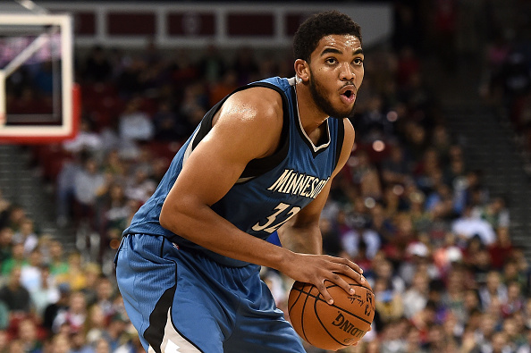 MADISON, WI - OCTOBER 20:  Karl-Anthony Towns #32 of the Minnesota Timberwolves handles the ball during a preseason game against the Milwaukee Bucks at the Kohl Center on October 20, 2015 in Madison, Wisconsin.  (Photo by Stacy Revere/Getty Images)