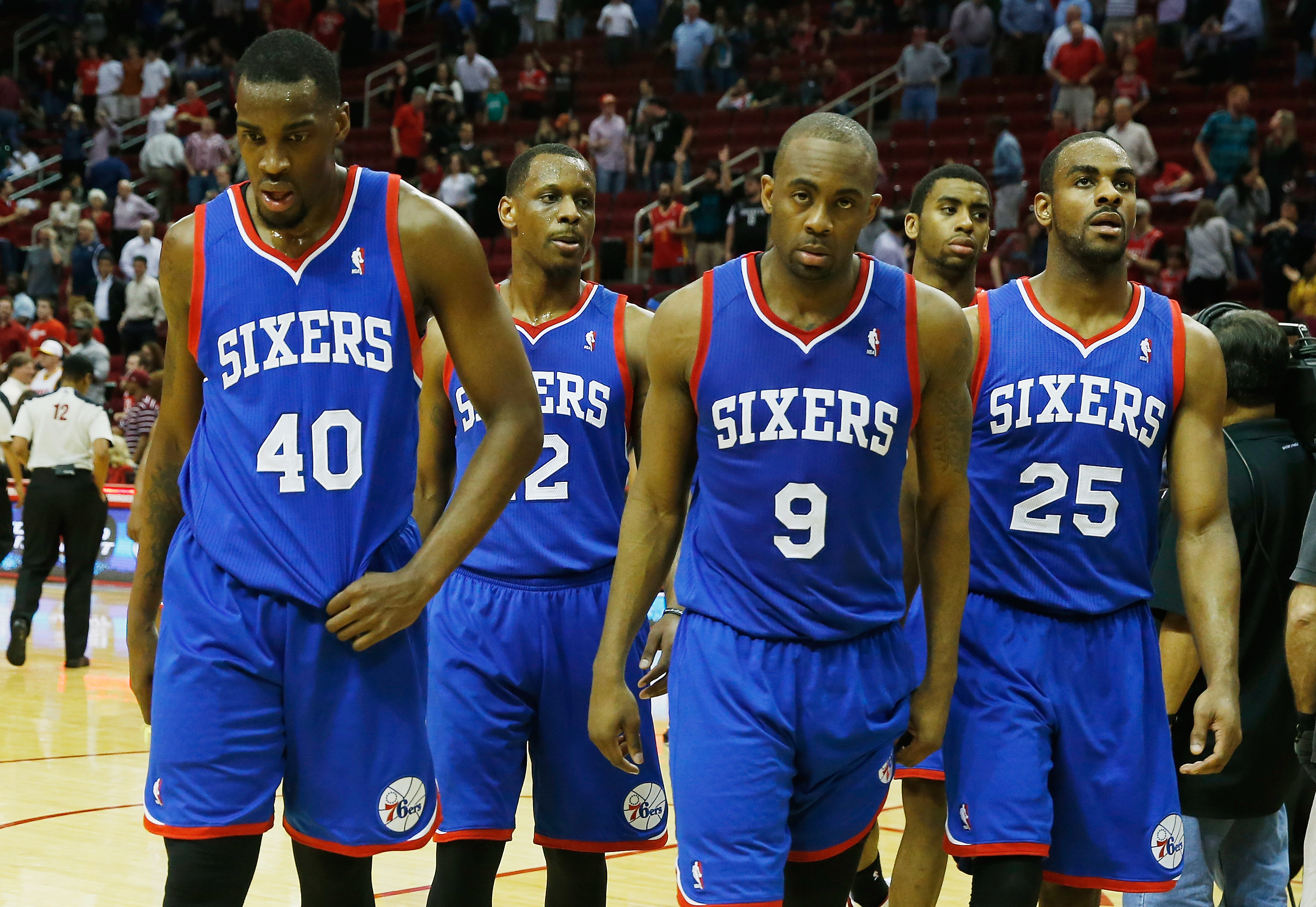 HOUSTON, TX - MARCH 27:  Jarvis Varnado #40, James Nunnally #12, James Anderson #9 and Elliot Williams #25 of the Philadelphia 76ers walk off the court after losing to the Houston Rockets 120-98 at the Toyota Center on March 27, 2014 in Houston, Texas.  T