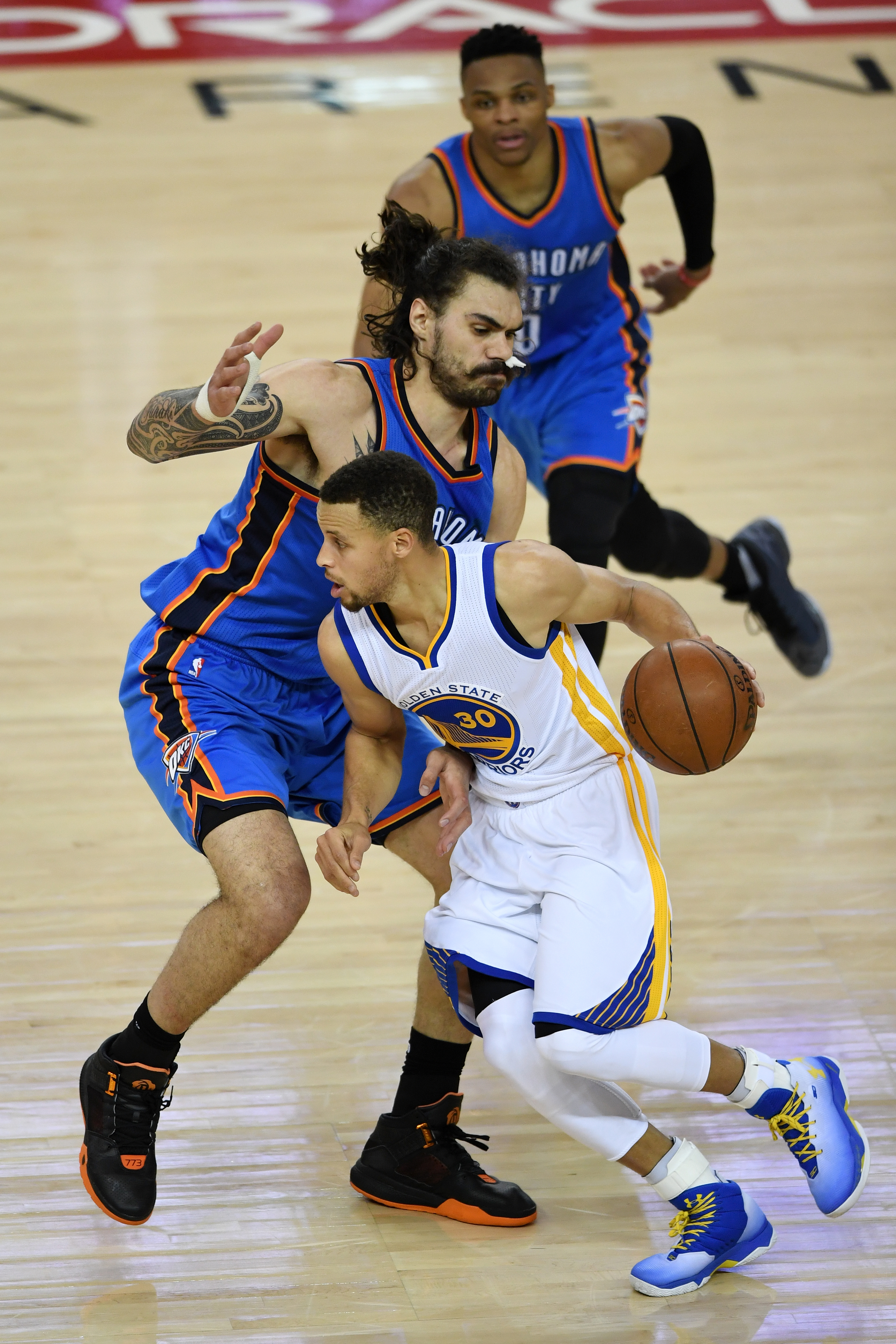 OAKLAND, CA - MAY 16:  Stephen Curry #30 of the Golden State Warriors drives with the ball against Steven Adams #12 of the Oklahoma City Thunder during game one of the NBA Western Conference Final at ORACLE Arena on May 16, 2016 in Oakland, California. (P