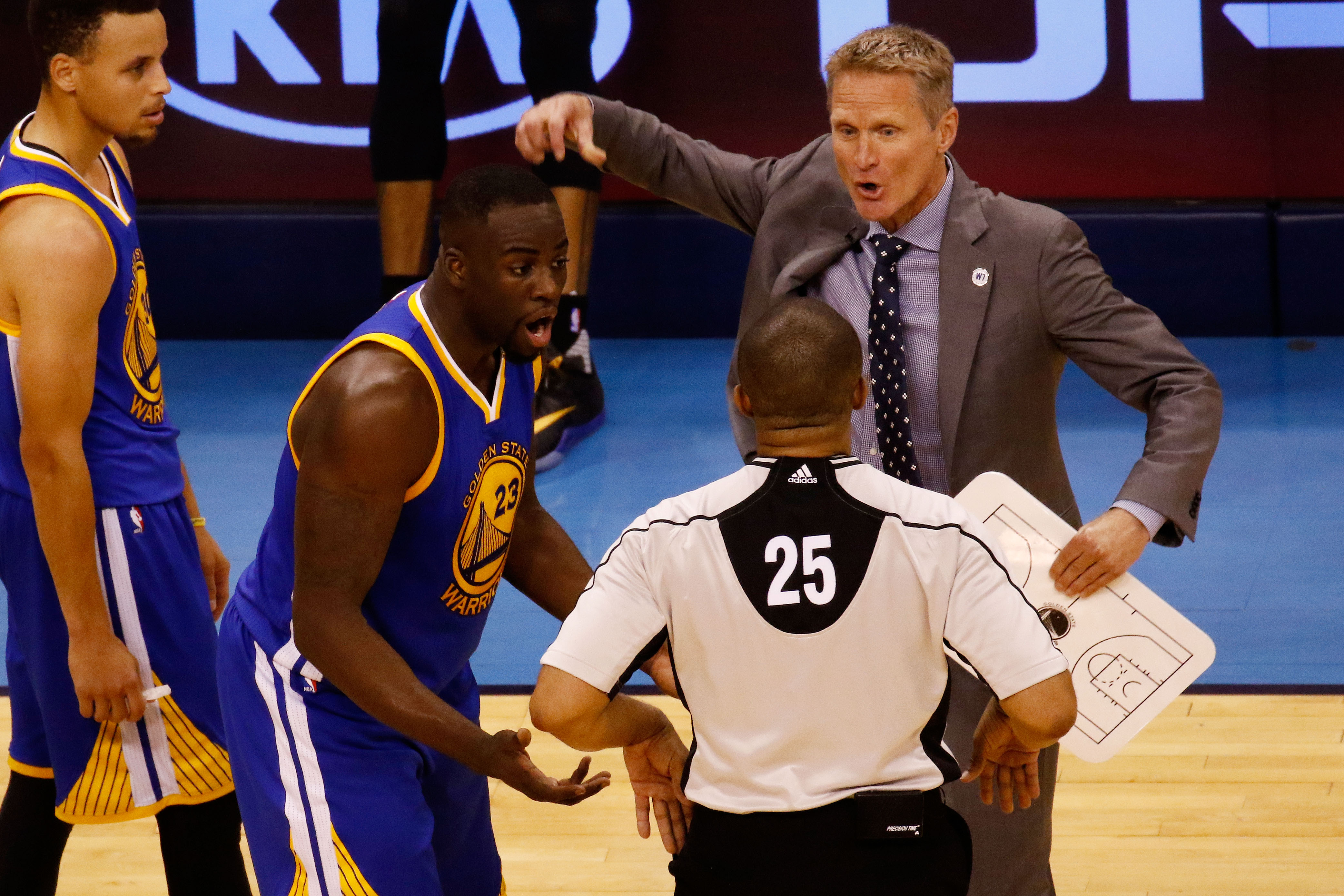 OKLAHOMA CITY, OK - MAY 22:  Head coach Steve Kerr and Draymond Green #23 of the Golden State Warriors argue with referee Tony Brothers #25 in the second quarter against the Oklahoma City Thunder in game three of the Western Conference Finals during the 2