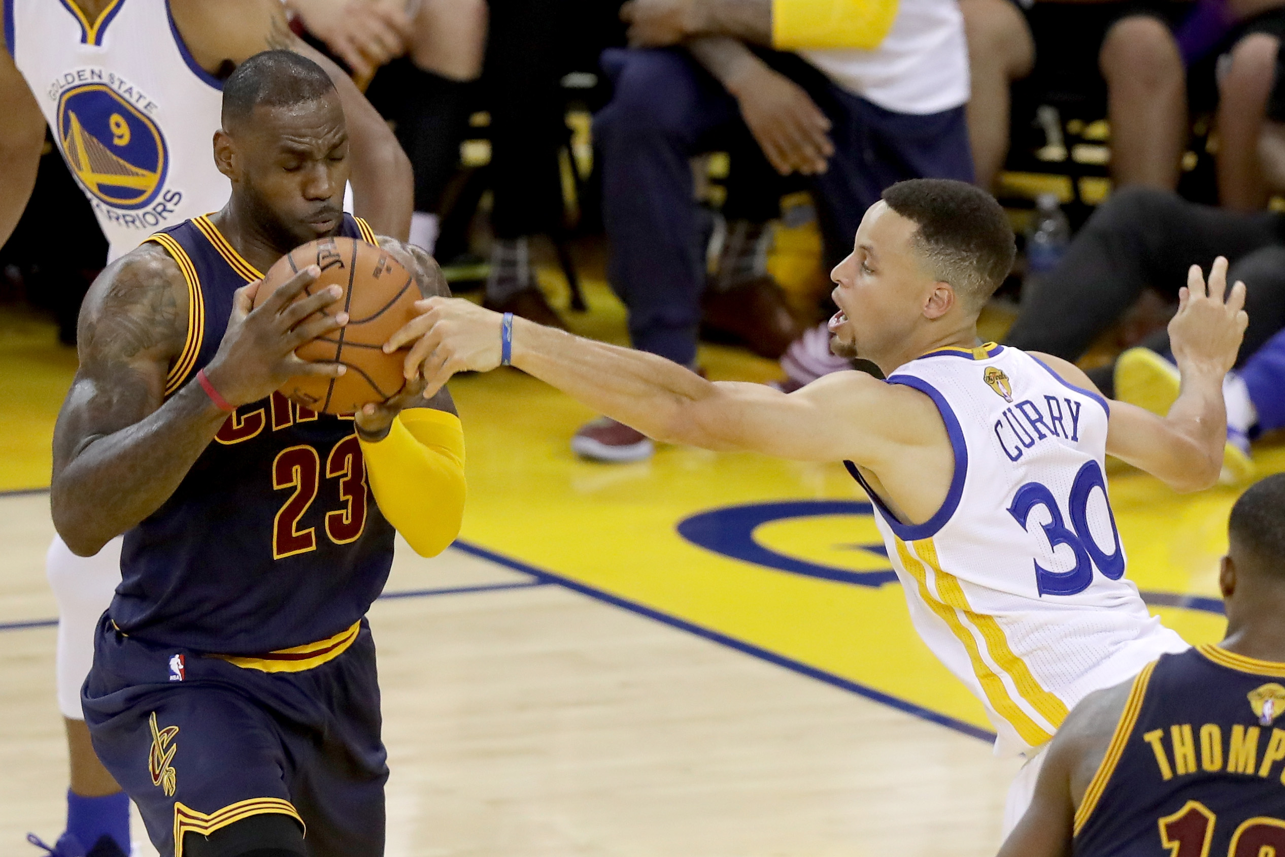 OAKLAND, CA - JUNE 02:  LeBron James #23 of the Cleveland Cavaliers with the ball against Stephen Curry #30 of the Golden State Warriors in the first half in Game 1 of the 2016 NBA Finals at ORACLE Arena on June 2, 2016 in Oakland, California. (Photo by R
