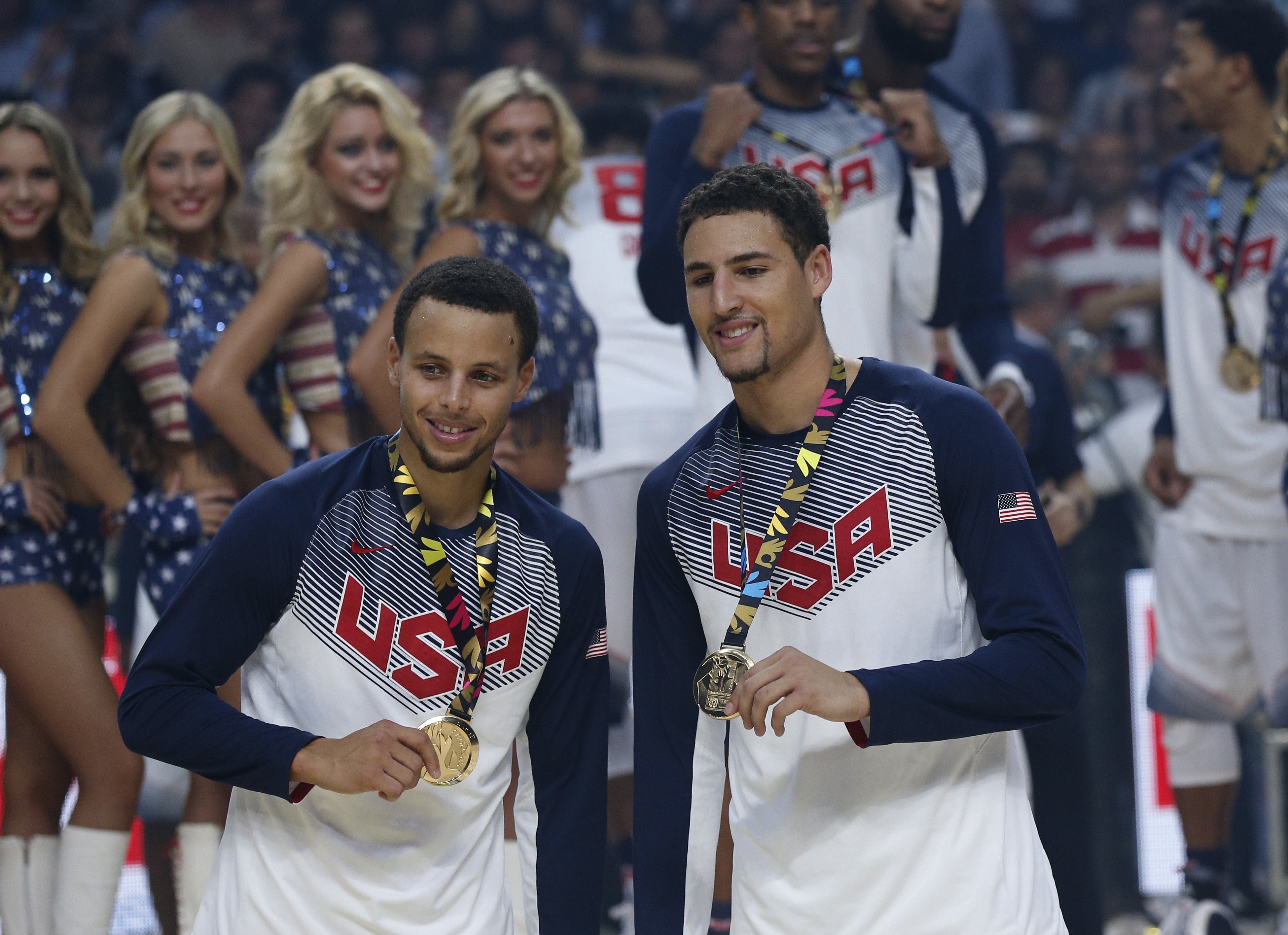 FILE - In this Sept. 14, 2014, file photo, United States' Stephen Curry, left, and Klay Thompson celebrate after wining the final World Basketball match against Serbia at the Palacio de los Deportes stadium in Madrid, Spain. Curry has withdrawn from consi