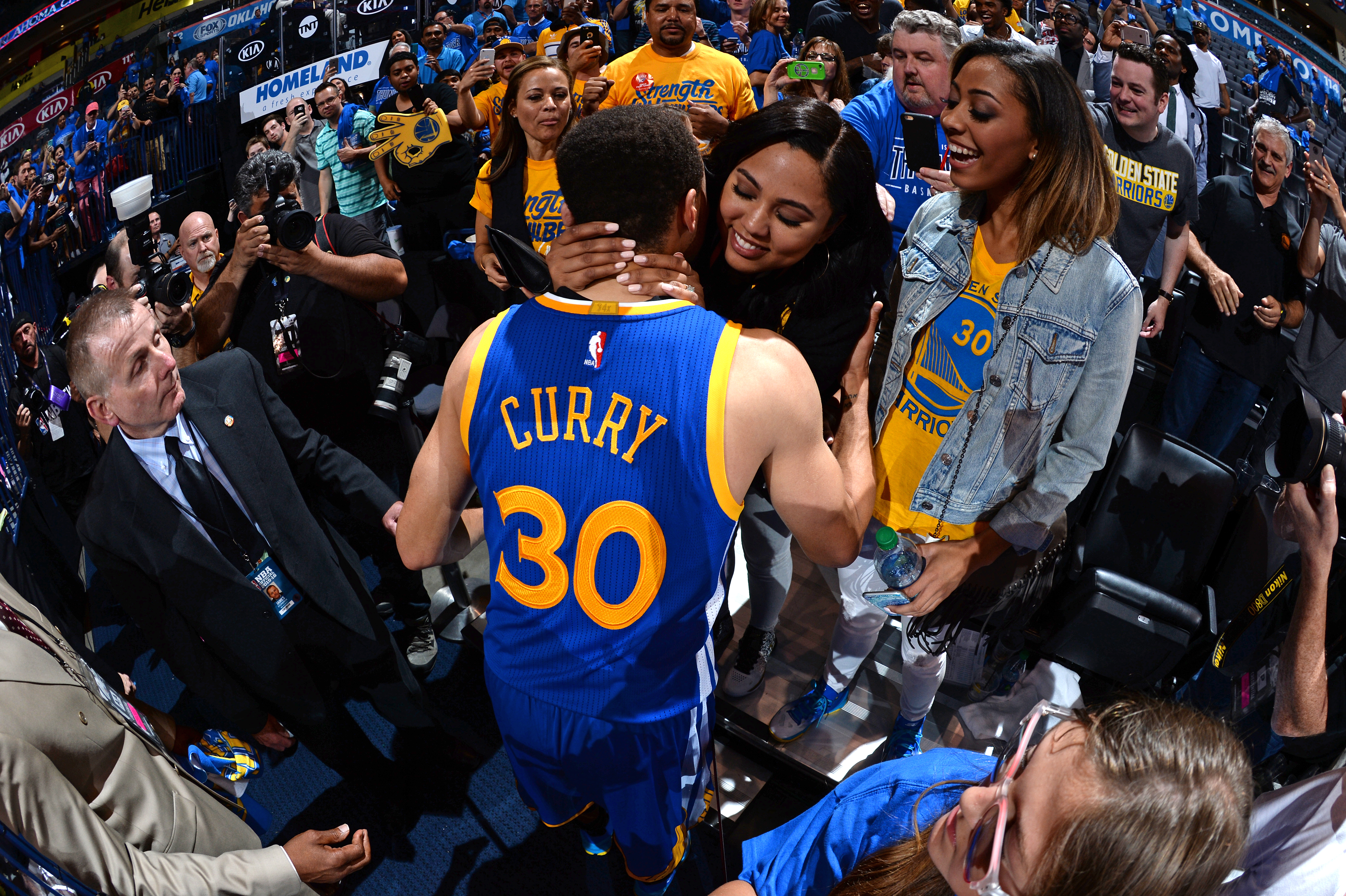OKLAHOMA CITY, OK - MAY 28:  Stephen Curry #30 of the Golden State Warriors celebrates with his wife Ayesha as he leaves the court after Game Six of the Western Conference Finals against the Oklahoma City Thunder during the 2016 NBA Playoffs on May 28, 20