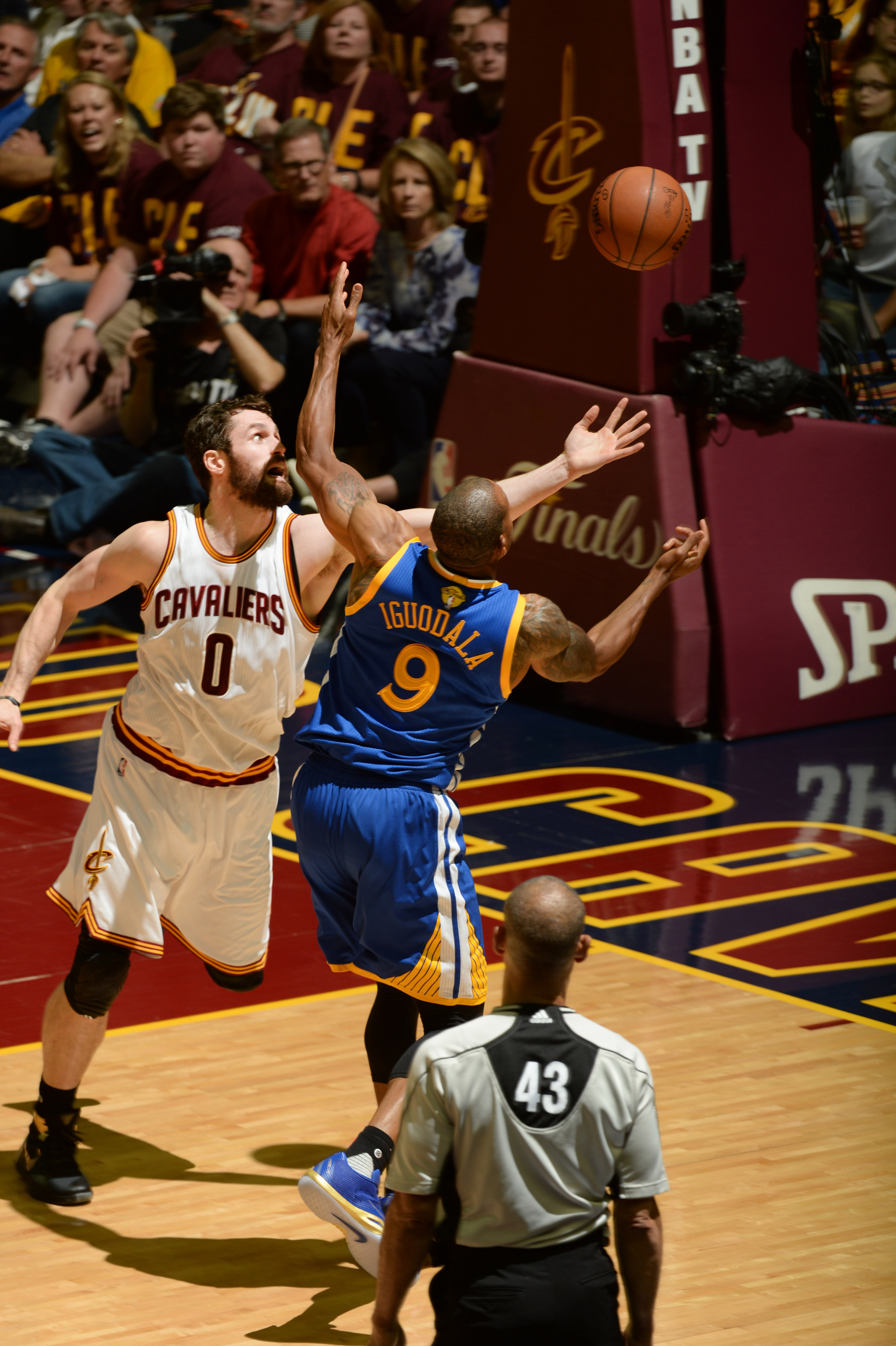 CLEVELAND, OH - JUNE 10: Kevin Love #0 of the Cleveland Cavaliers reaches for the rebound against Andre Iguodala #9 of the Golden State Warriors during Game Four of the 2016 NBA Finals on June 10, 2016 at Quicken Loans Arena in Cleveland, Ohio. (Photo by
