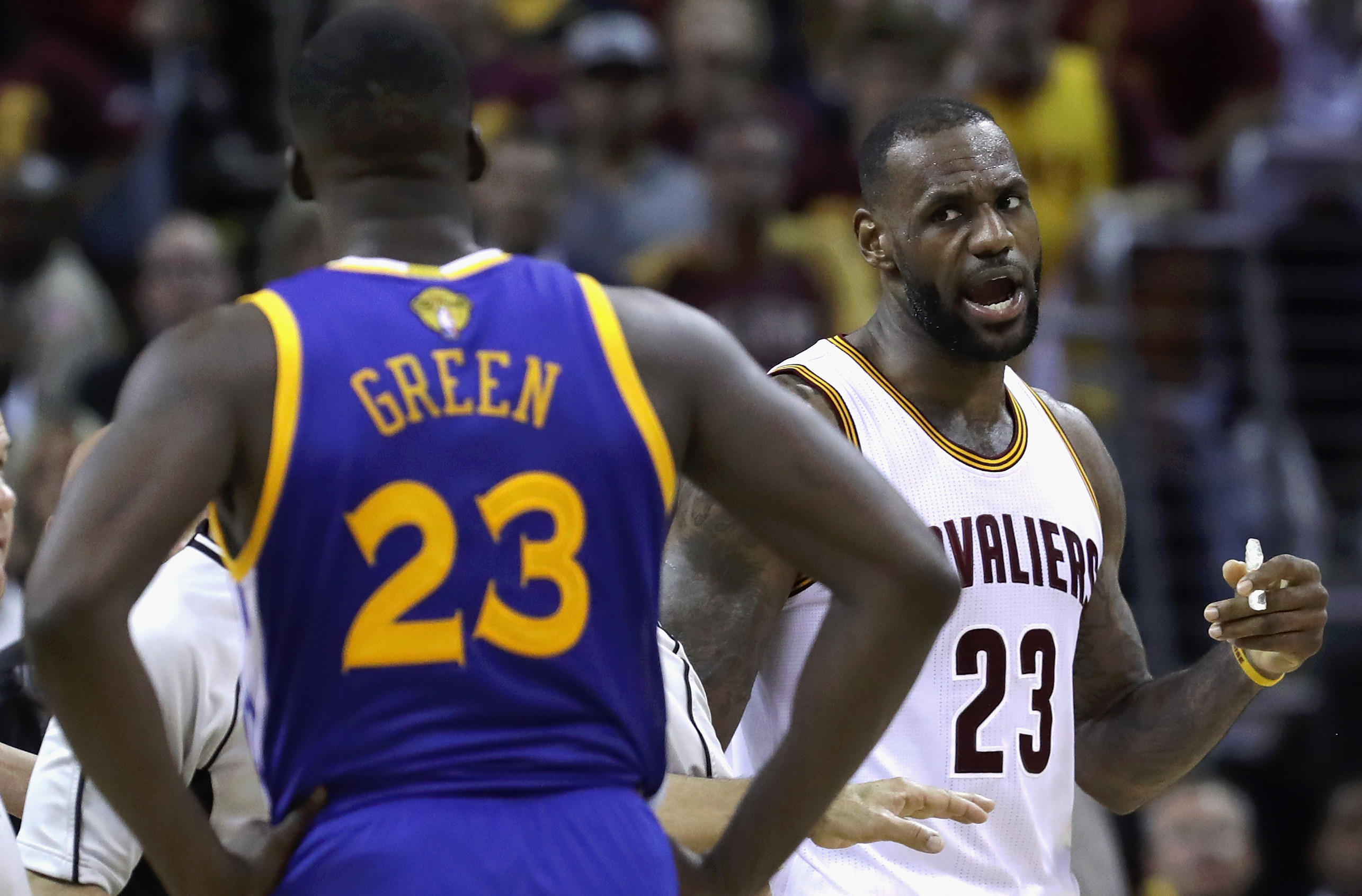 CLEVELAND, OH - JUNE 10:  LeBron James #23 of the Cleveland Cavaliers and Draymond Green #23 of the Golden State Warriors exchange words during a time out during the fourth quarter in Game 4 of the 2016 NBA Finals at Quicken Loans Arena on June 10, 2016 i
