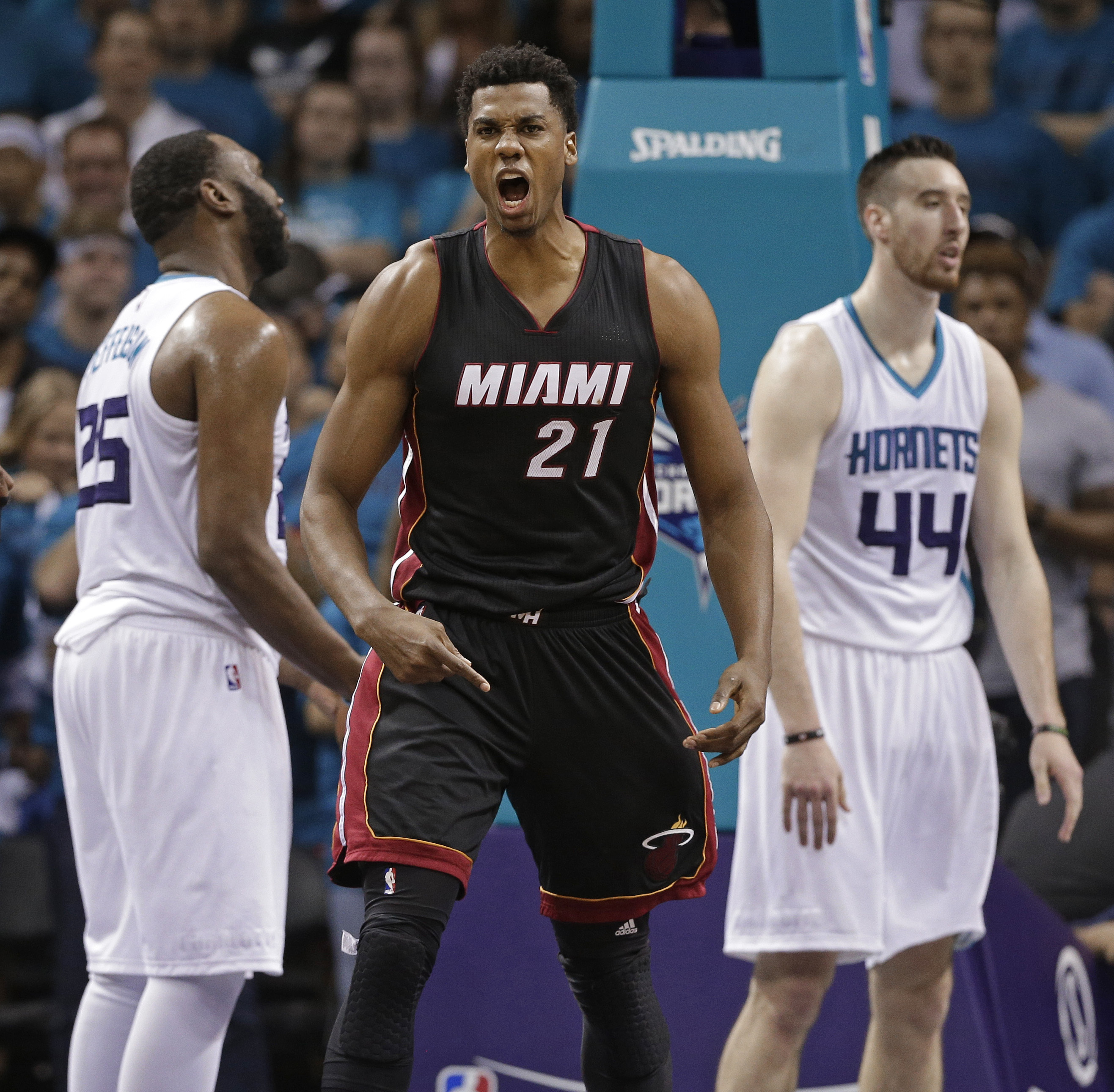 FILE - In this Friday, April 29, 2016, file photo, Miami Heat's Hassan Whiteside (21) reacts to making a basket and being fouled by Charlotte Hornets' Frank Kaminsky (44) during the second half in Game 6 of an NBA basketball playoffs first-round series in