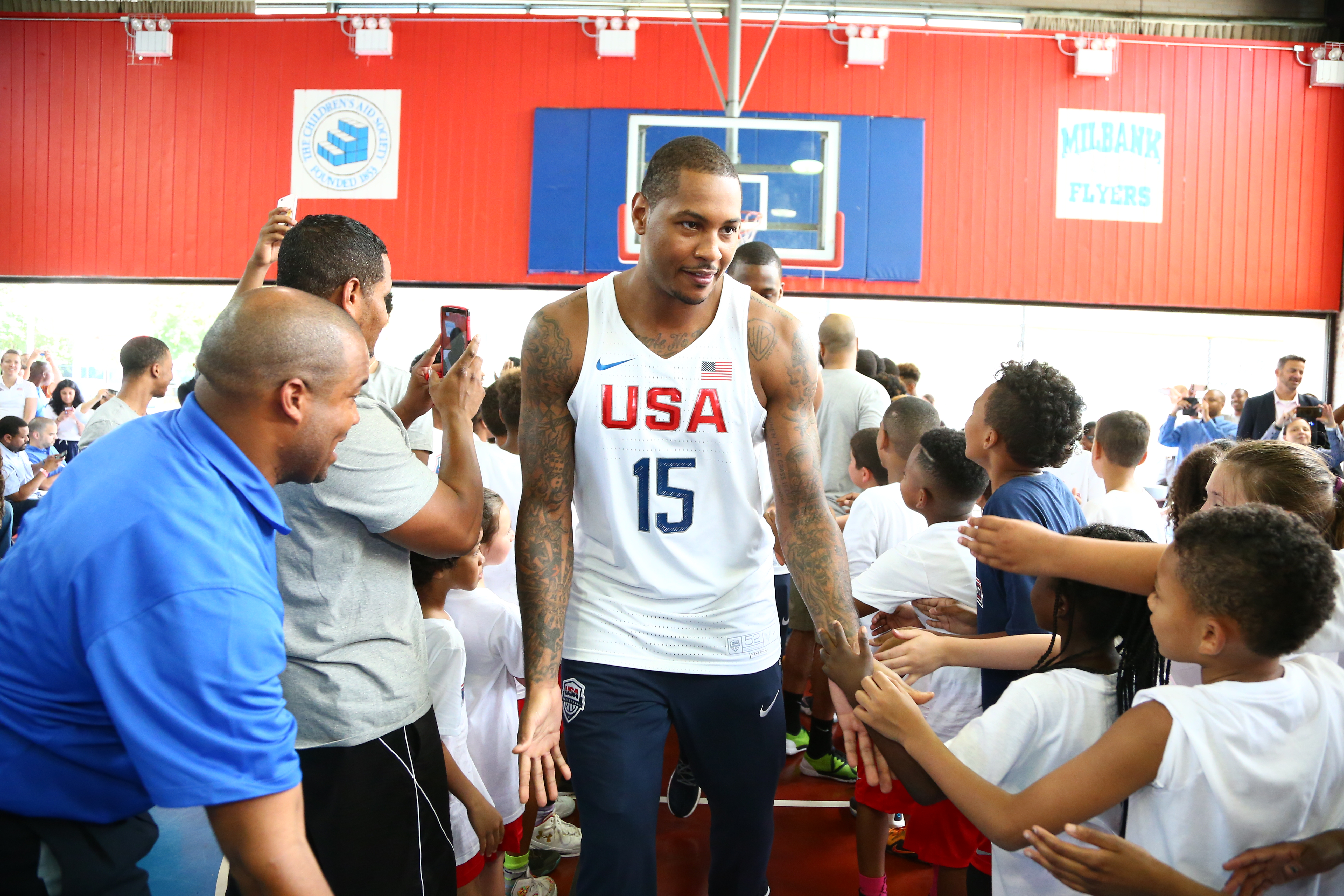 NEW YORK, NY - JUNE 27:  Carmelo Anthony #15 of the 2016 USA Men's Senior National Basketball Team shakes hands with some fans during a press conference at Dunleavy Milbank Center on June 27, 2016 in New York City. (Photo by Nathaniel S. Butler/NBAE via G