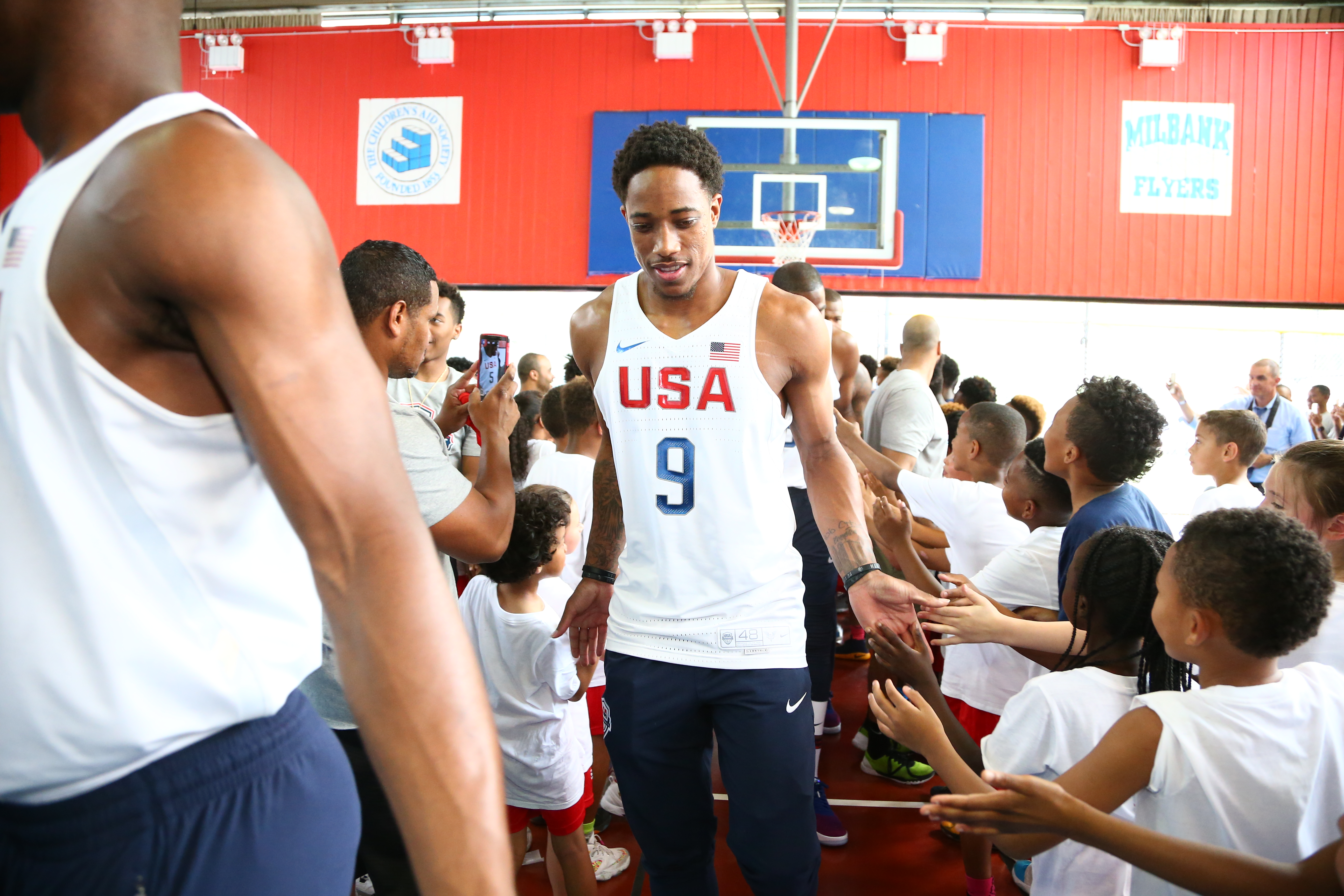 NEW YORK, NY - JUNE 27:  DeMar DeRozan #9 of the 2016 USA Men's Senior National Basketball Team shakes hands with some fans during a press conference at Dunleavy Milbank Center on June 27, 2016 in New York City. (Photo by Nathaniel S. Butler/NBAE via Gett