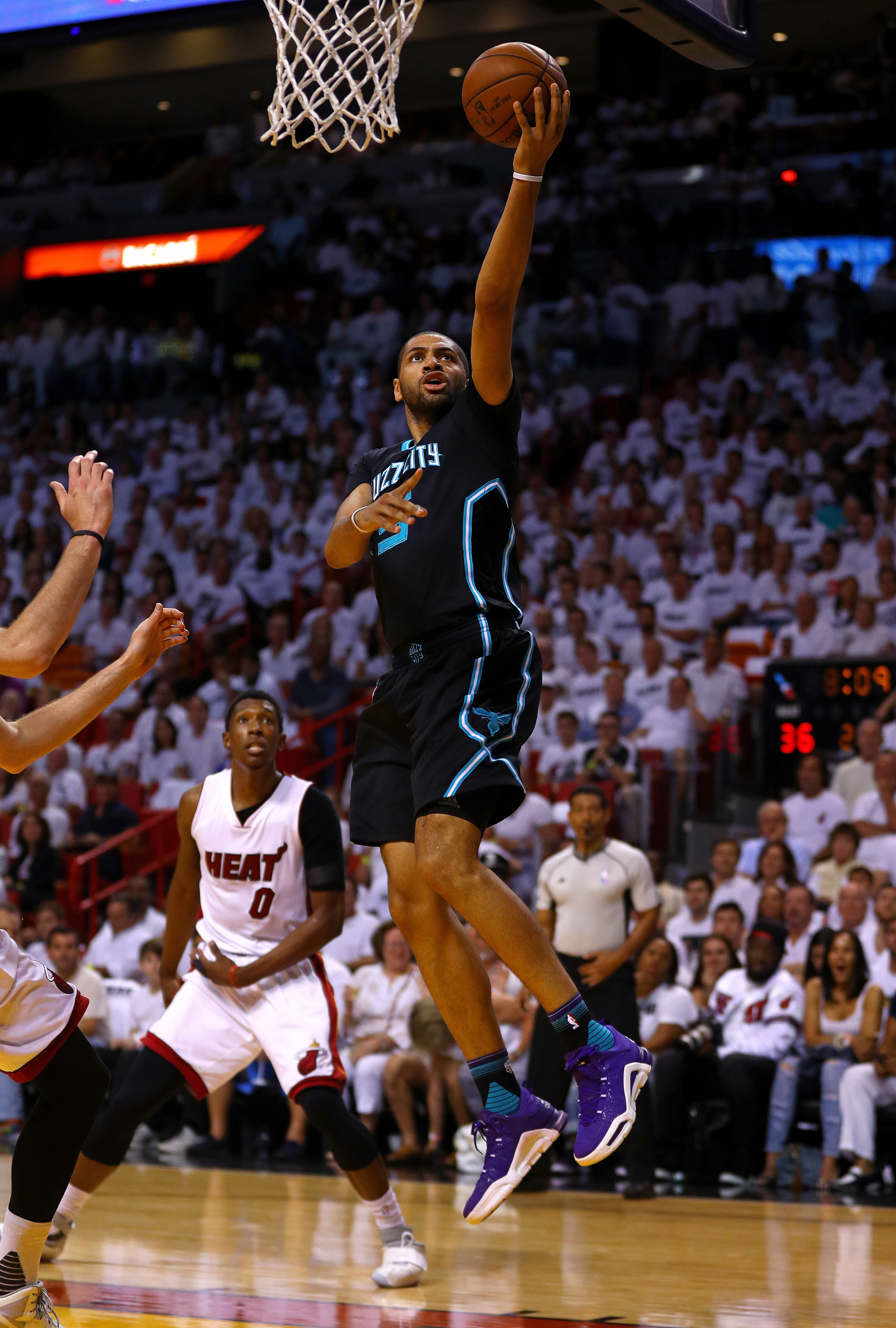 MIAMI, FL - MAY 01: Nicolas Batum #5 of the Charlotte Hornets drives to the basket during Game Seven of the Eastern Conference Quarterfinals of the 2016 NBA Playoffs against the Miami Heat at American Airlines Arena on May 1, 2016 in Miami, Florida. NOTE