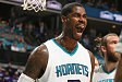 CHARLOTTE, NC - APRIL 25: Marvin Williams #24 of the Charlotte Hornets celebrates against the Miami Heat during Game Four of the Eastern Conference Quarterfinals during the 2016 NBA Playoffs on April 25, 2016 at Time Warner Cable Arena in Charlotte, North