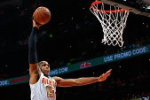 ATLANTA, GA - MAY 06:  Al Horford #15 of the Atlanta Hawks dunks against Kevin Love #0 of the Cleveland Cavaliers in Game Three of the Eastern Conference Semifinals during the 2016 NBA Playoffs at Philips Arena on May 6, 2016 in Atlanta, Georgia.  NOTE TO
