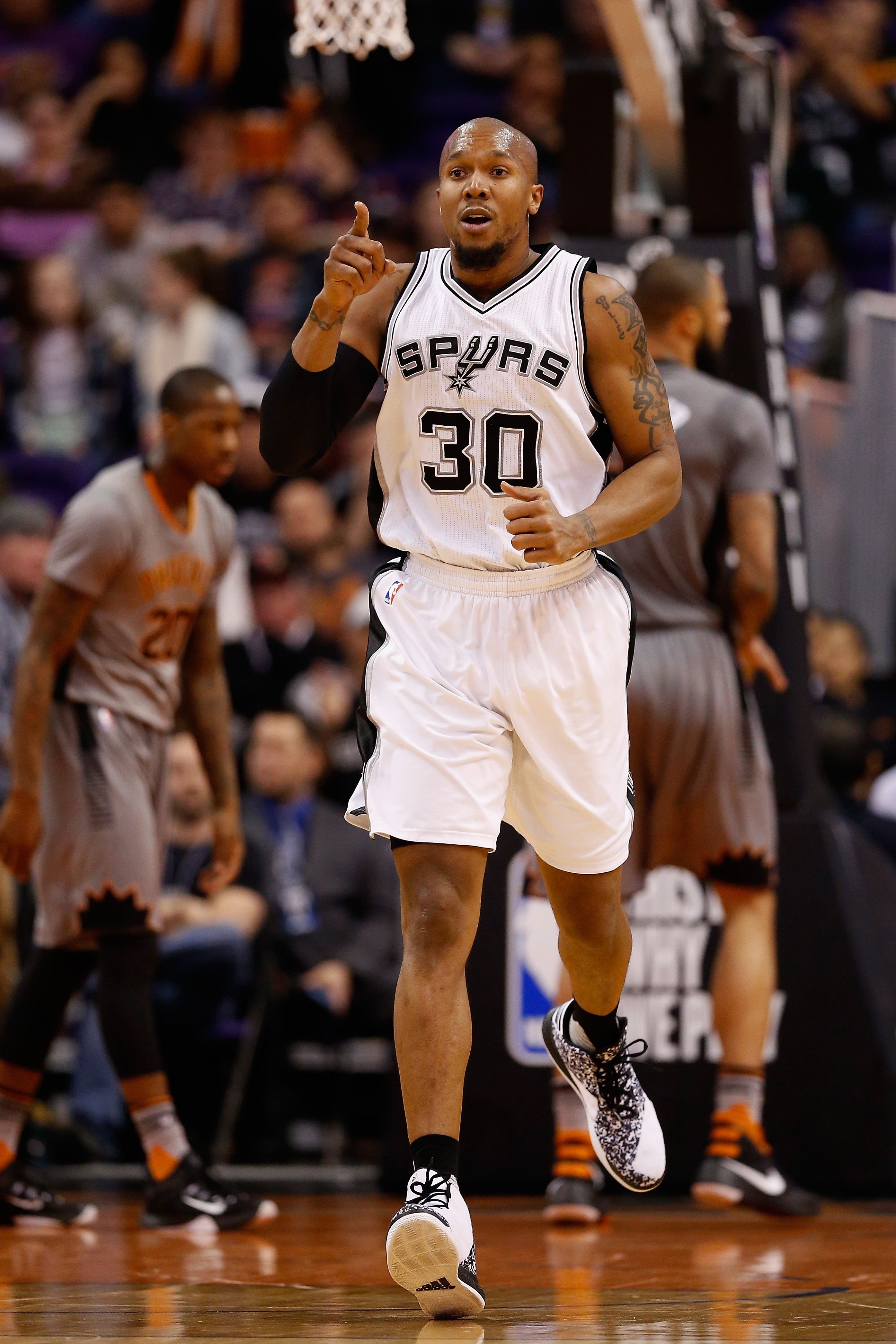 PHOENIX, AZ - JANUARY 21:  David West #30 of the San Antonio Spurs reacts after scoring during the first half of the NBA game against the Phoenix Suns at Talking Stick Resort Arena on January 21, 2016 in Phoenix, Arizona.  (Photo by Christian Petersen/Get
