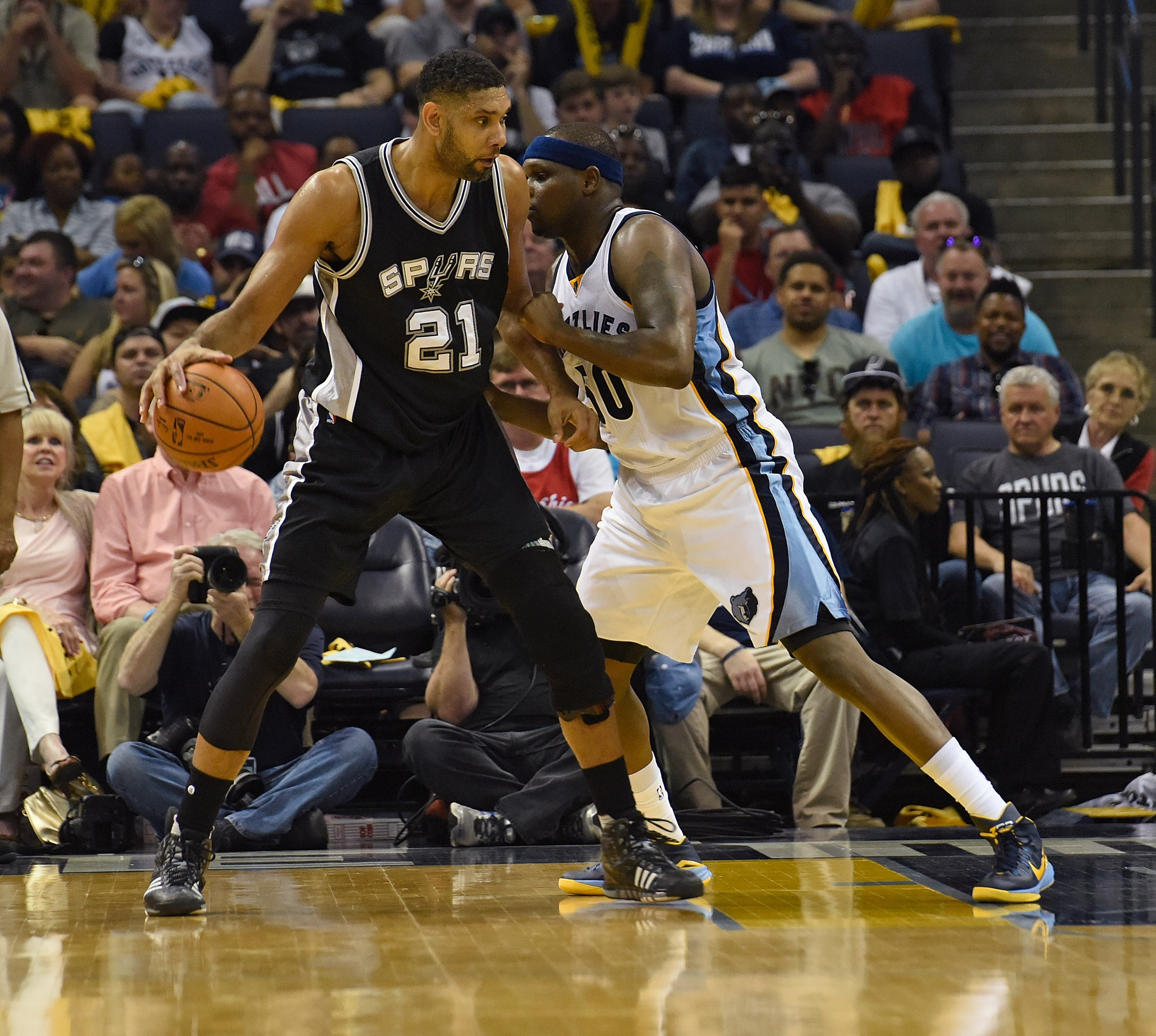 FILE - JULY 11, 2016: It was reported that Tim Duncan of the San Antonio Spurs is retiring from the NBA after 19 seasons July 11, 2016. MEMPHIS, TN - APRIL 24:  Tim Duncan #21 of the San Antonio Spurs dribbles against Zach Randolph #50 of the Memphis Griz