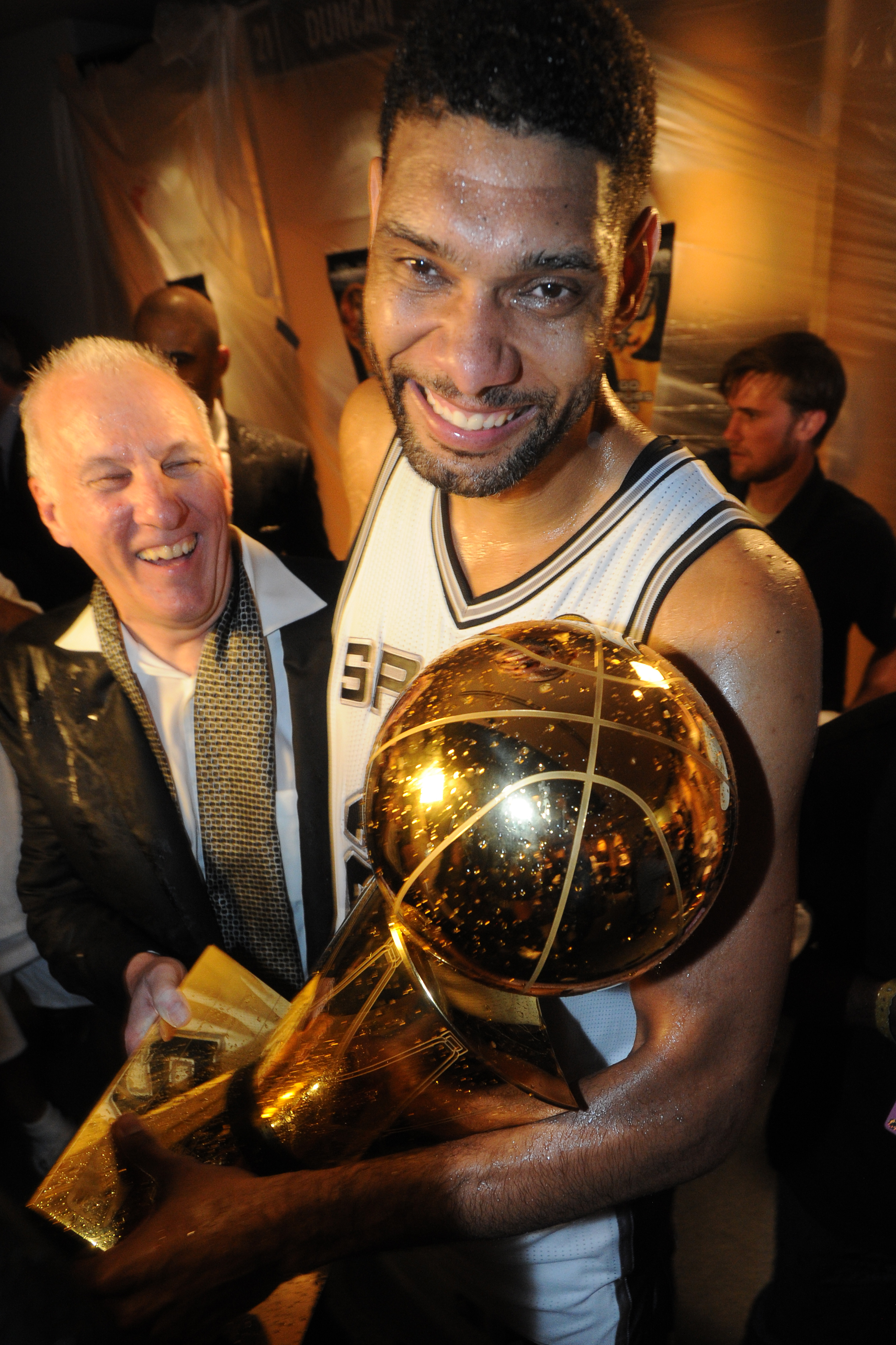 SAN ANTONIO, TX - JUNE 15: Tim Duncan #21 and Head Coach Gregg Popovich of the San Antonio Spurs looks on against the Miami Heat during Game Five of the 2014 NBA Finals between the Miami Heat and San Antonio Spurs at AT&T Center on June 15, 2014 in San An