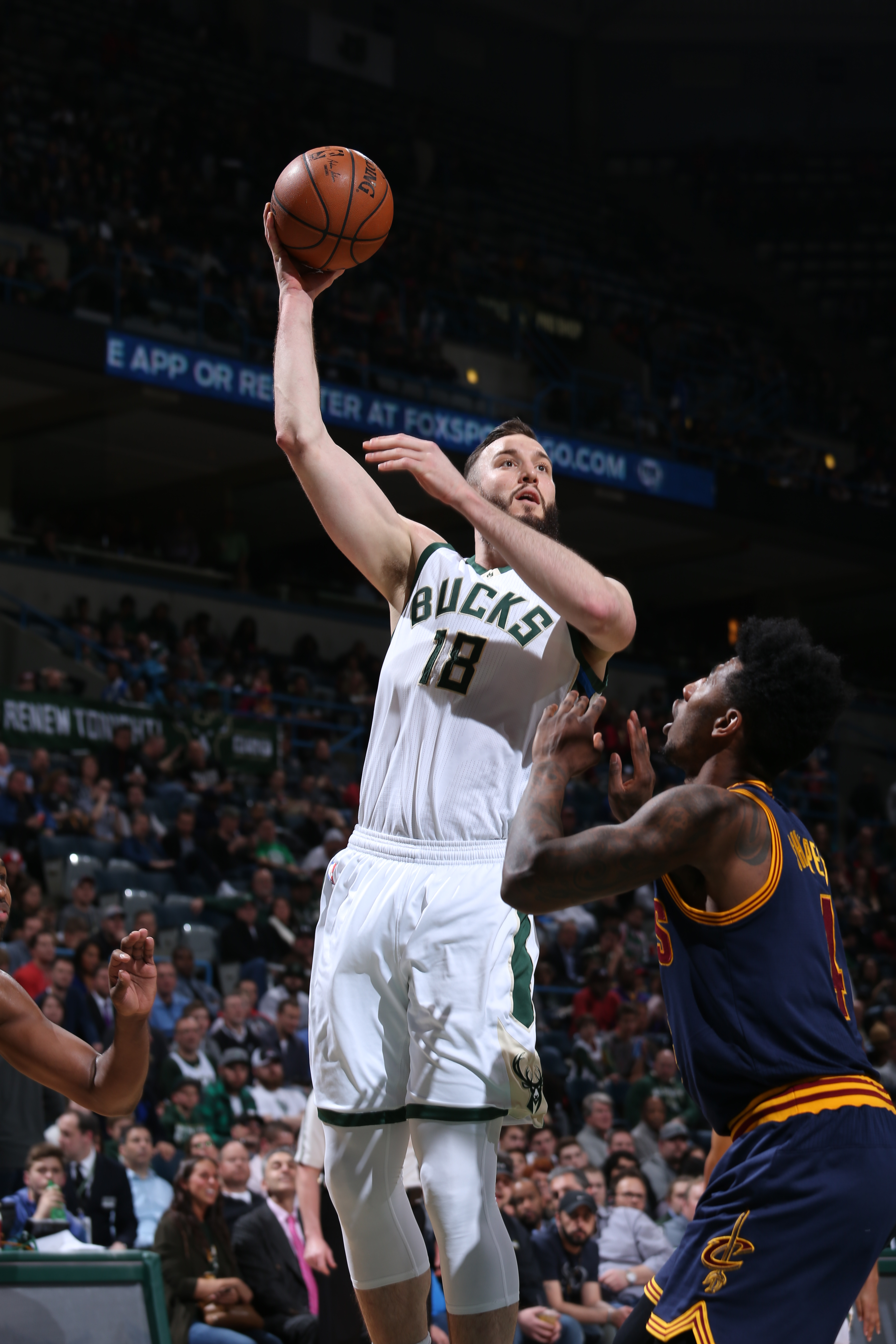 MILWAUKEE, WI - APRIL 5:  Miles Plumlee #18 of the Milwaukee Bucks shoots against the Cleveland Cavaliers on April 5, 2016 at the BMO Harris Bradley Center in Milwaukee, Wisconsin. (Photo by Gary Dineen/NBAE via Getty Images)