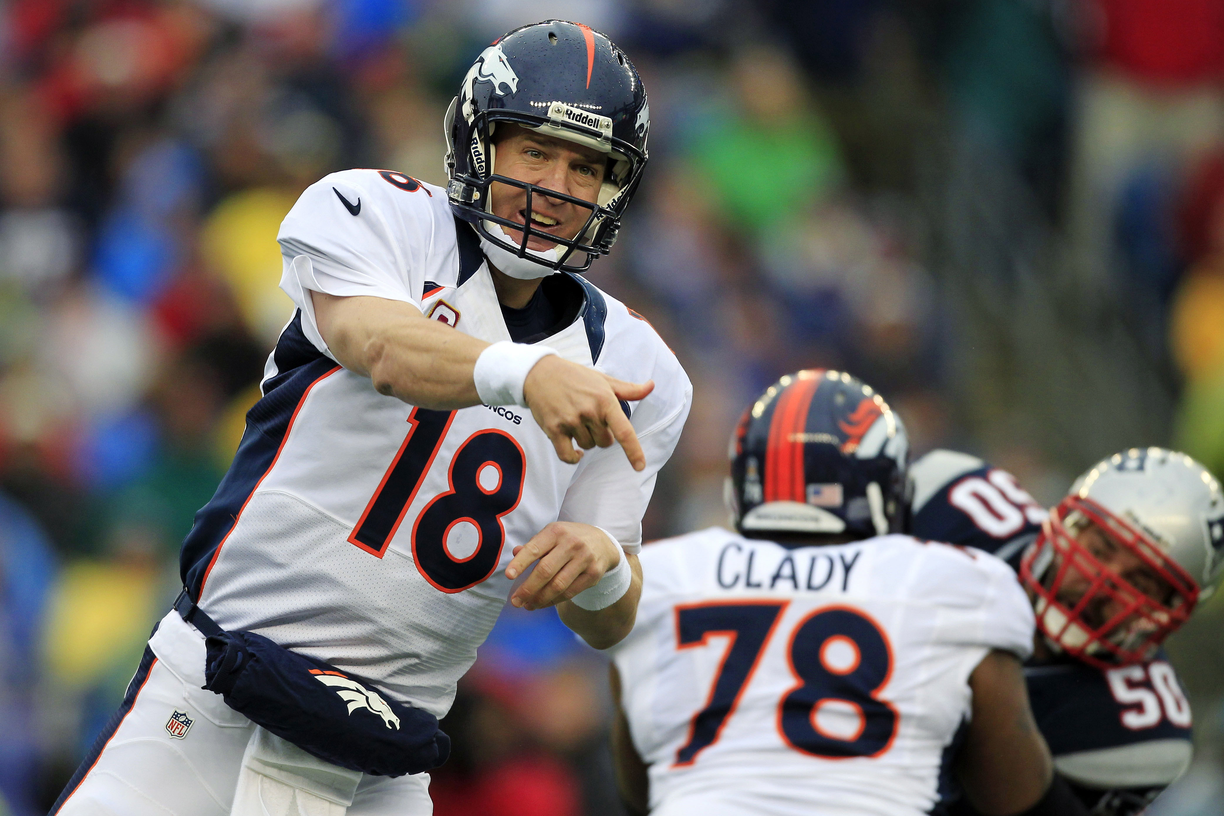 FILE - In this Sunday, Oct. 7, 2012 file photo, Denver Broncos quarterback Peyton Manning (18) follows through on a pass as tackle Ryan Clady (78) blocks New England Patriots defensive end Rob Ninkovich (50) in the first half of an NFL football game in Fo