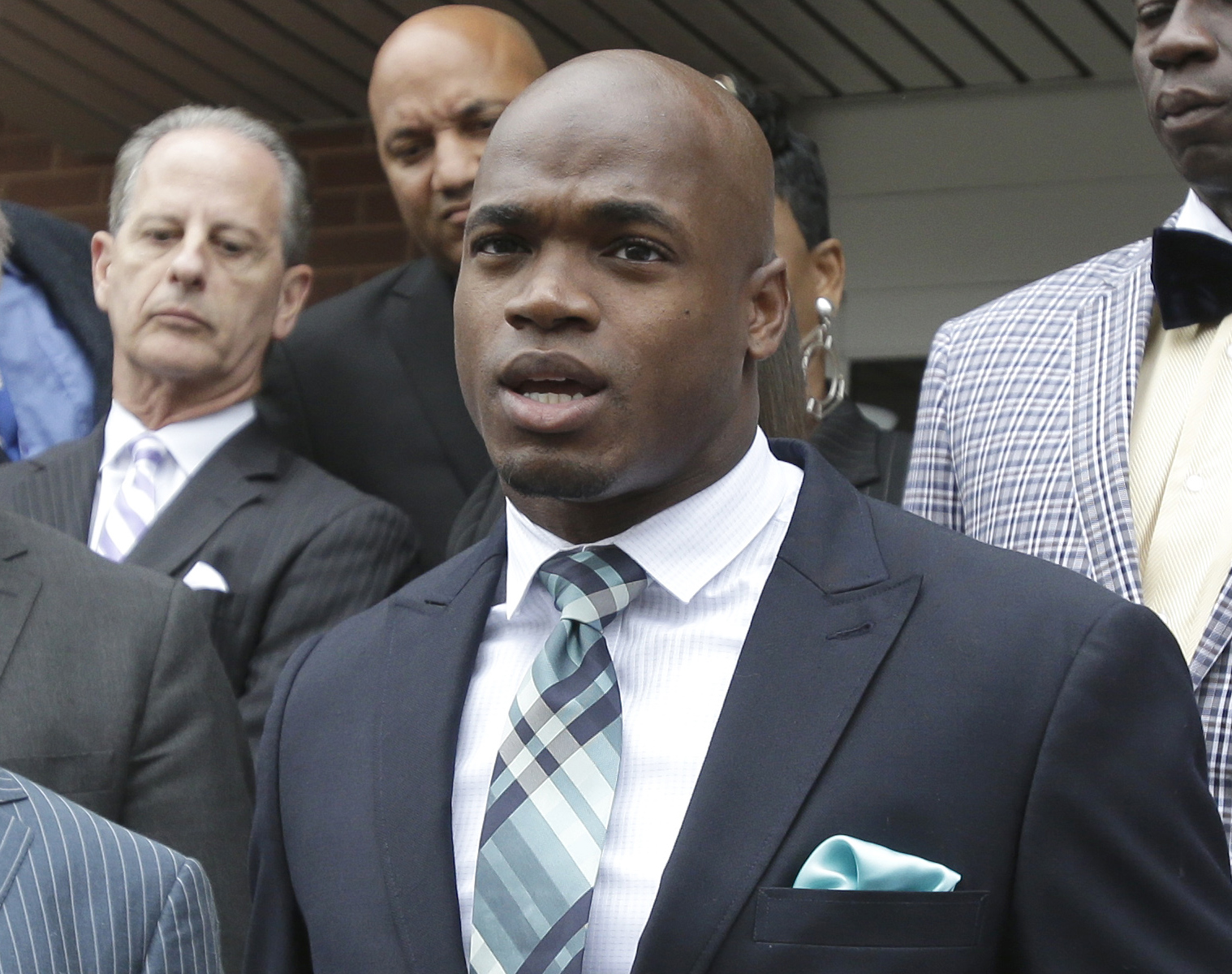 FILE - In this Nov. 4, 2014, file photo, Minnesota Vikings running back Adrian Peterson speaks to the media after pleading no contest to an assault charge in Conroe, Texas. On Friday, Dec. 12, 2014, the league-appointed arbitrator for Peterson's appeal af