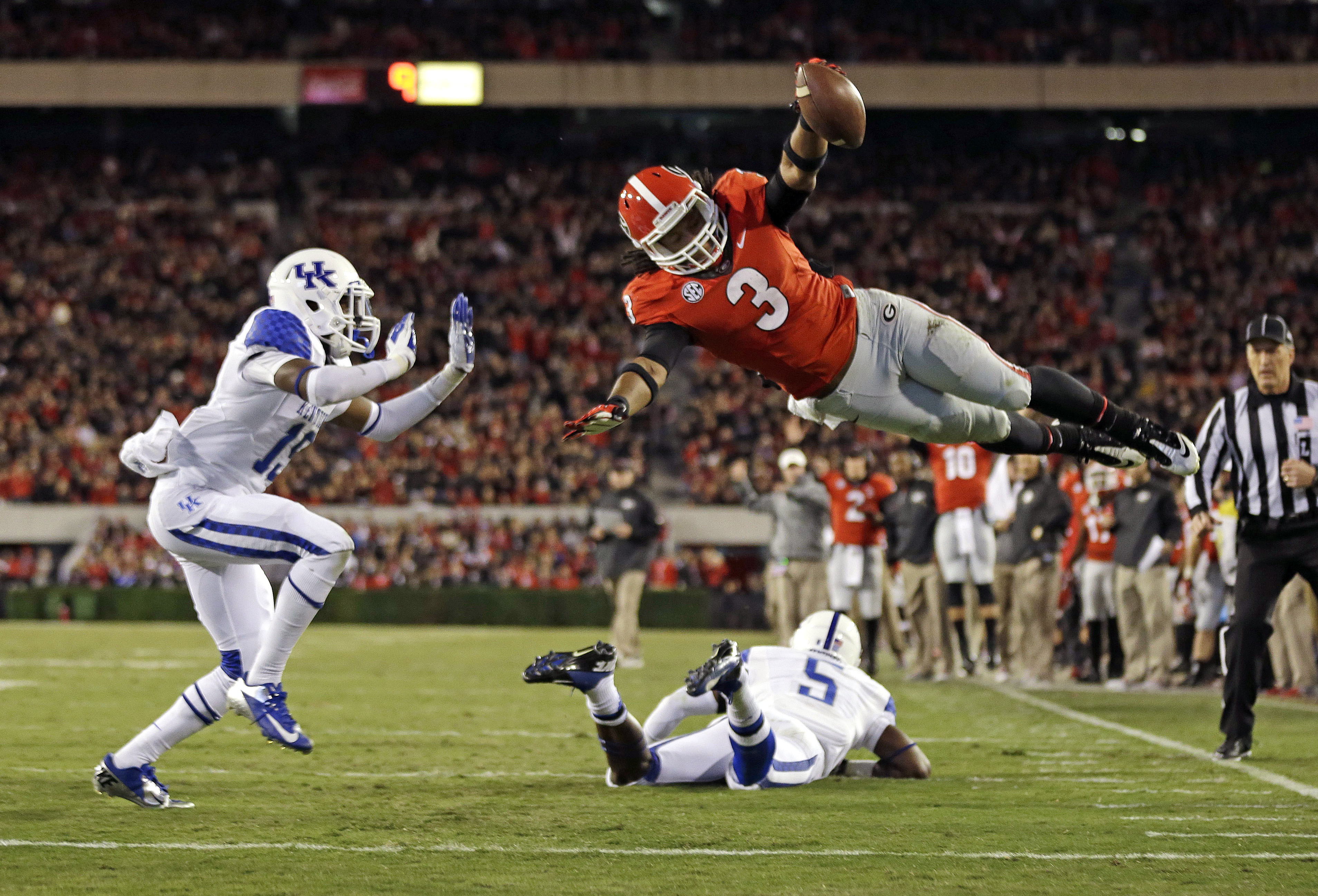 ADVANCE FOR WEEKEND EDITIONS, APRIL 24-25 _ FILE - In this Nov. 23, 2013, file photo, Georgia running back Todd Gurley (3) dives into the end zone for a touchdown as Kentucky cornerback Jaleel Hytchye (19) defends in the first half of an NCAA college foot