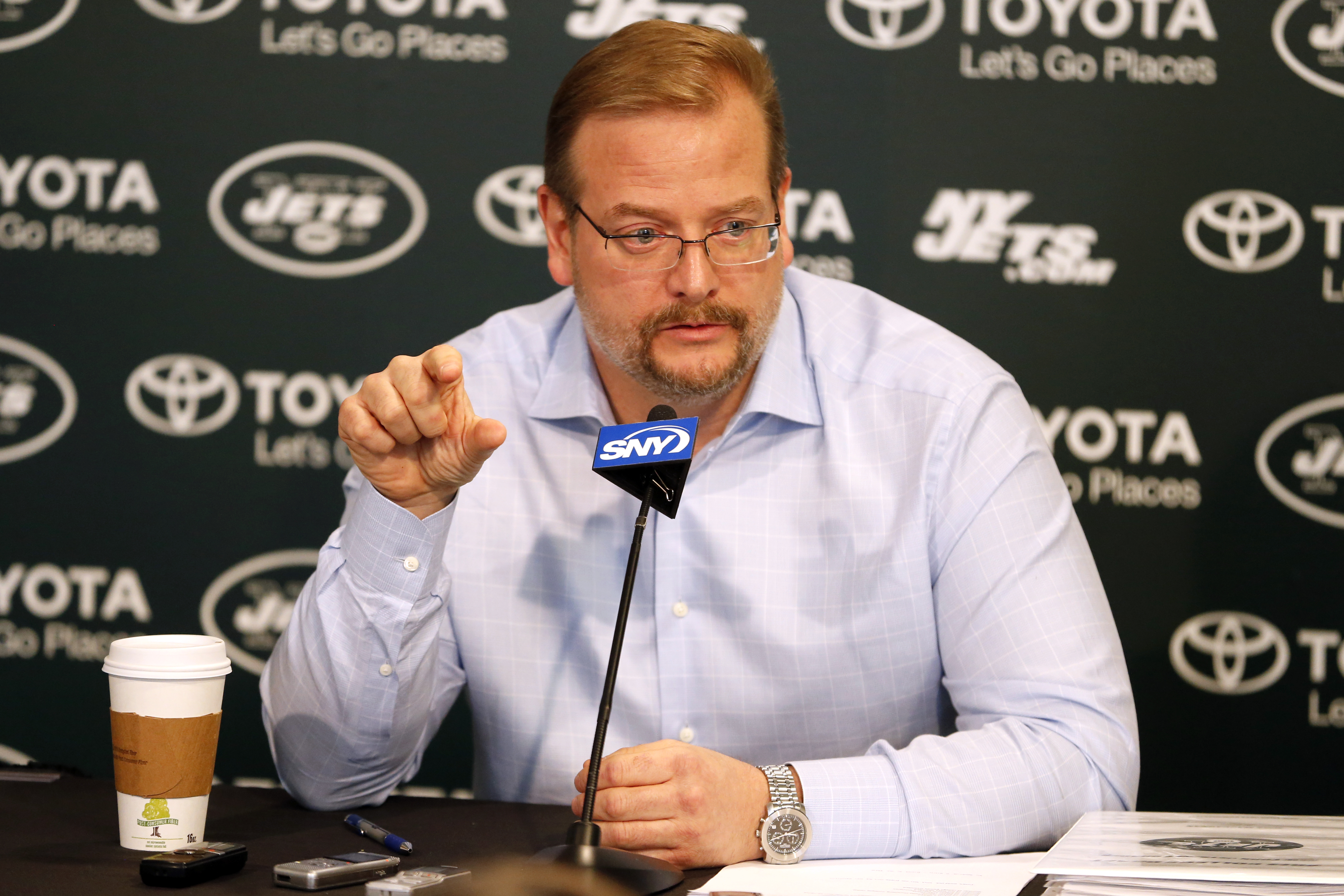 New York Jets general manager Mike Maccagnan speaks to reporters ahead of the NFL football draft, during a news conference, Friday, April 24, 2015, in Florham Park, N.J. (AP Photo/Julio Cortez)