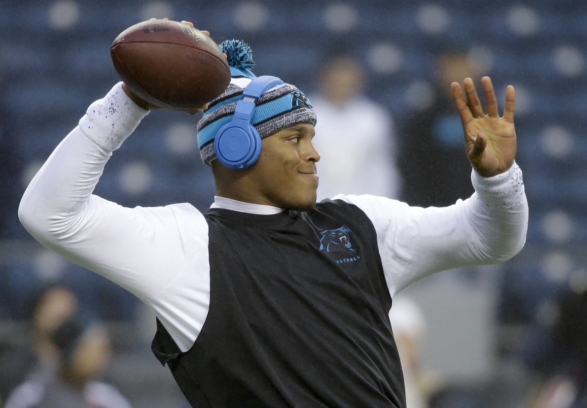 Carolina Panthers quarterback Cam Newton throws before an NFL divisional playoff football game against the Seattle Seahawks in Seattle, Saturday, Jan. 10, 2015. (AP Photo/Elaine Thompson)