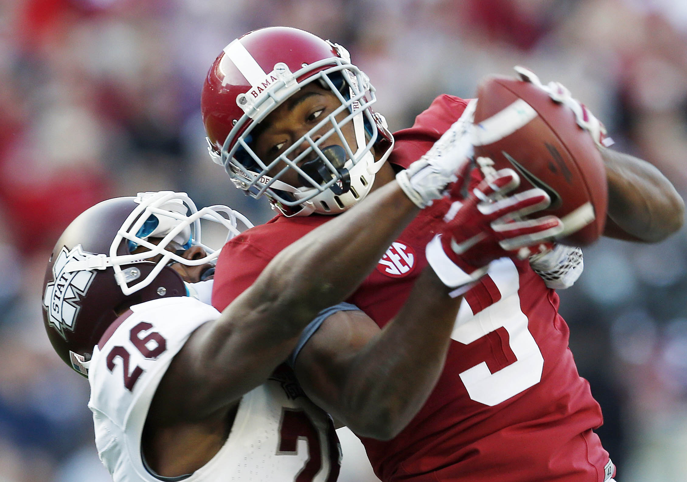 FILE - In this Nov. 15, 2014, file photo, Alabama wide receiver Amari Cooper (9) catches a 50-yard pass against Mississippi State defensive back Kendrick Market (26) in the first half of an NCAA college football game in Tuscaloosa, Ala. There will be seve