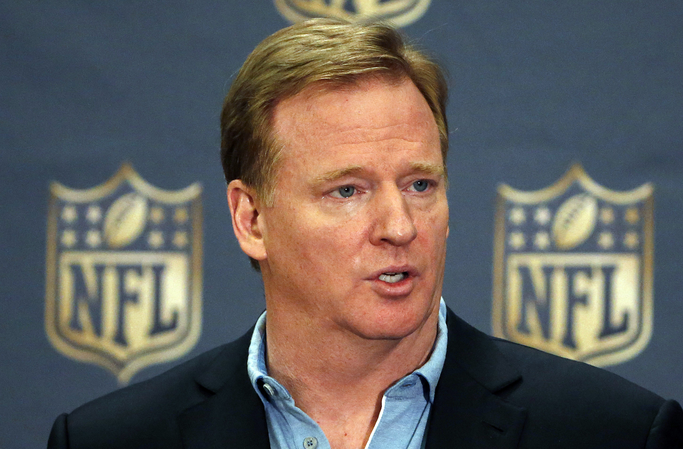 FILE - In this March 25, 2015, file photo, NFL Commissioner Roger Goodell addresses the media at a news conference at the NFL Annual Meeting in Phoenix. Goodell says the two stadium projects in the Los Angeles area look promising enough to lead to the ret