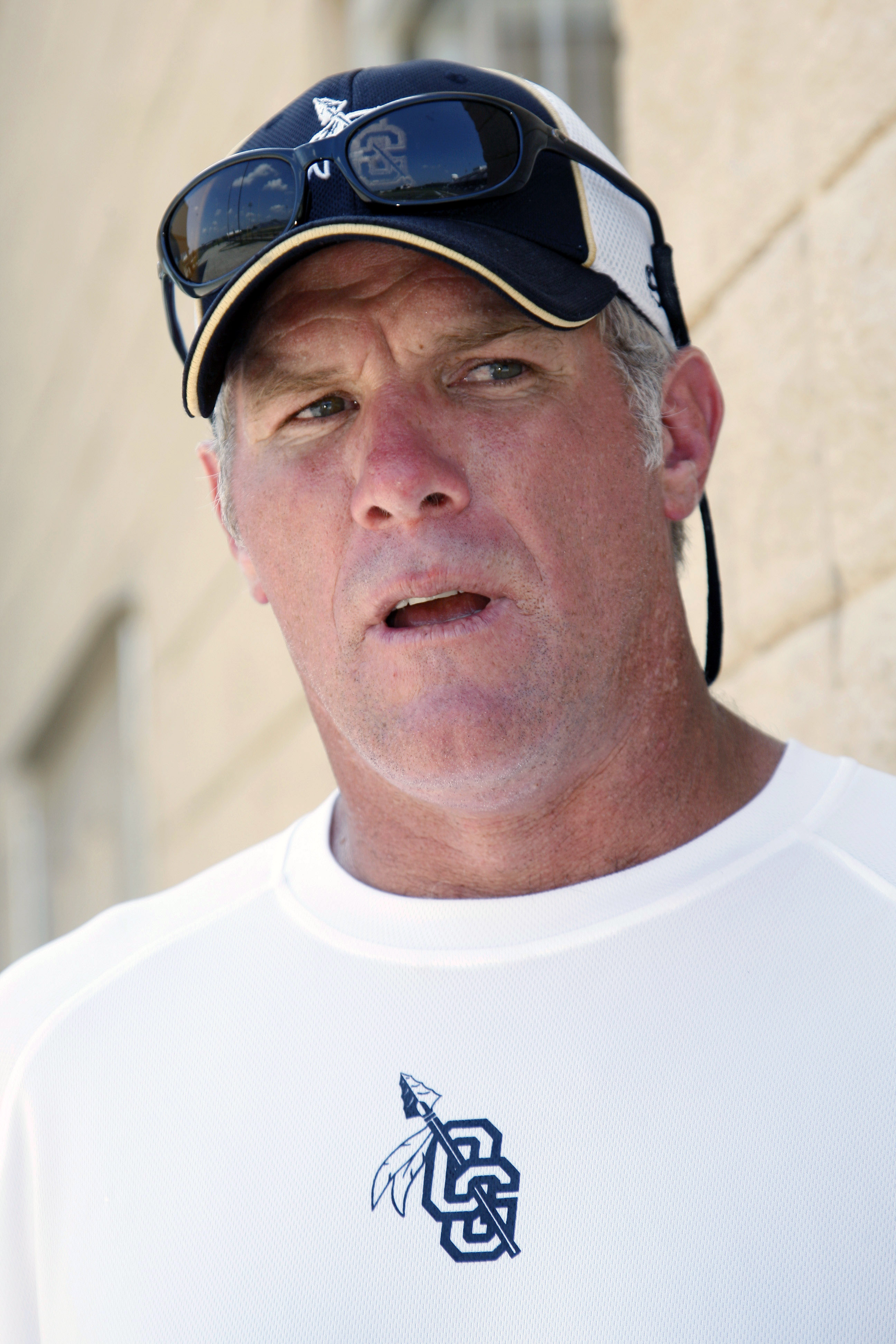 Former NFL quarterback Brett Favre, now an assistant football coach at Oak Grove High School in Hattiesburg, Miss., speaks about the transition from player to coach during the first day of official practice for the fall high school football season, Monday
