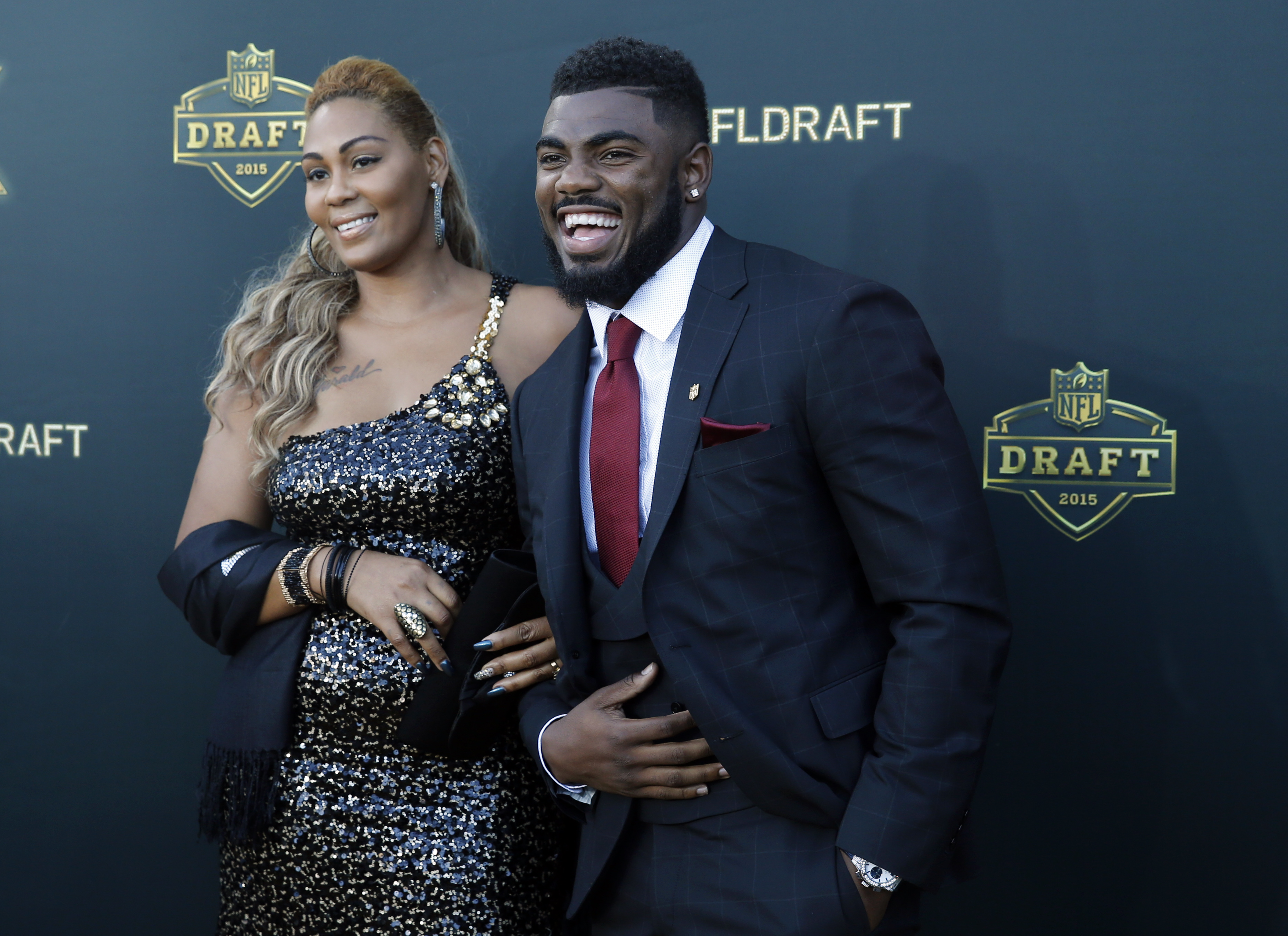 Alabama defensive back Landon Collins poses for photos his mother April Justin, upon arriving for the first round of the 2015 NFL Football Draft at the Auditorium Theater of Roosevelt University, Thursday, April 30, 2015, in Chicago. (AP Photo/Charles Rex